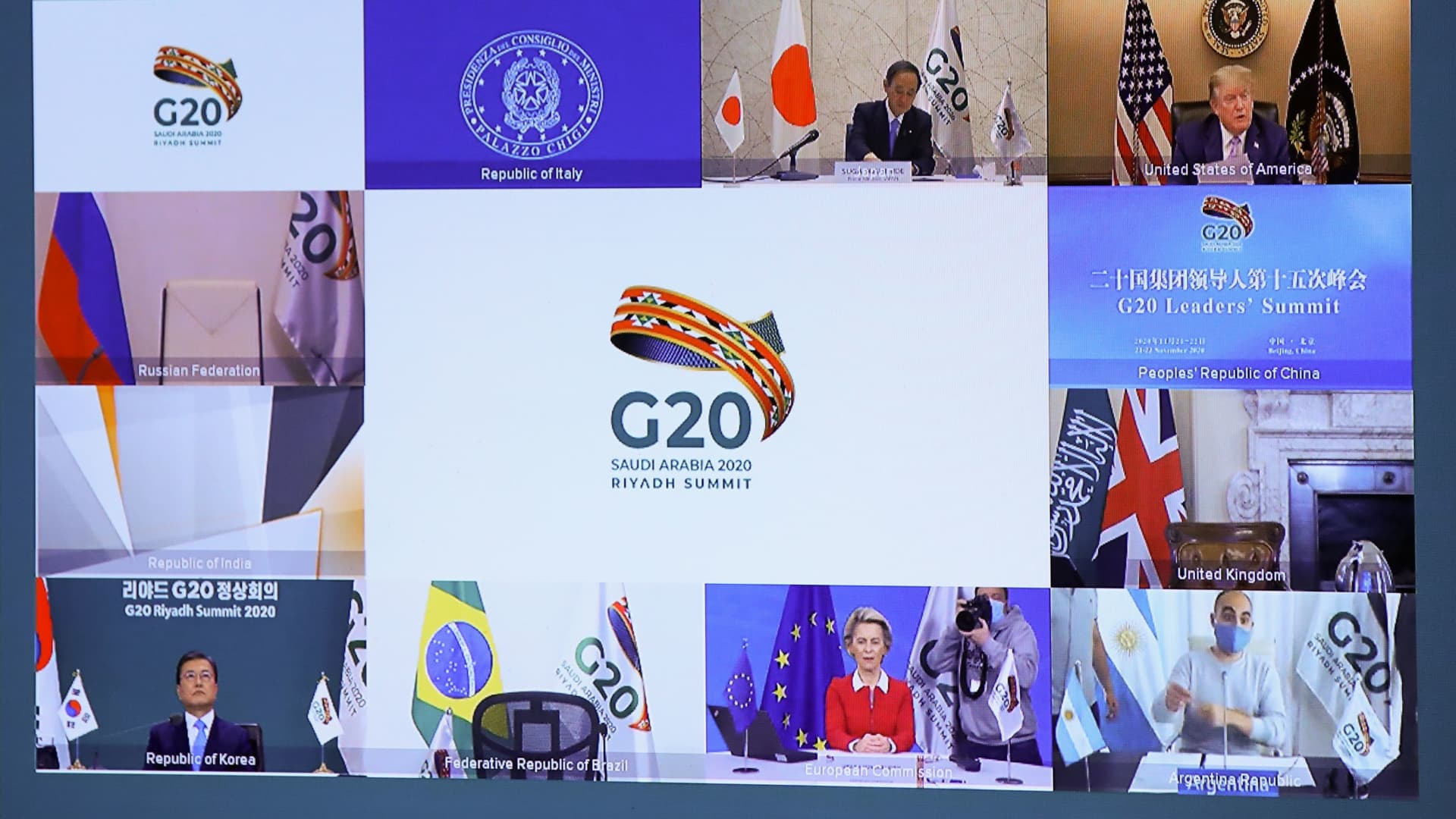 Japanese Prime Minister Yoshihide Suga (top L), US President Donald Trump (top R), South Korean President Moon Jae-in (down L), and European Commission President Ursula von der Leyen (down C) are seen on a screen before the start of a virtual G20 summit hosted by Saudi Arabia and held over video conference amid the Covid-19 (novel coronavirus) pandemic, in Brussels, on November 21, 2020.