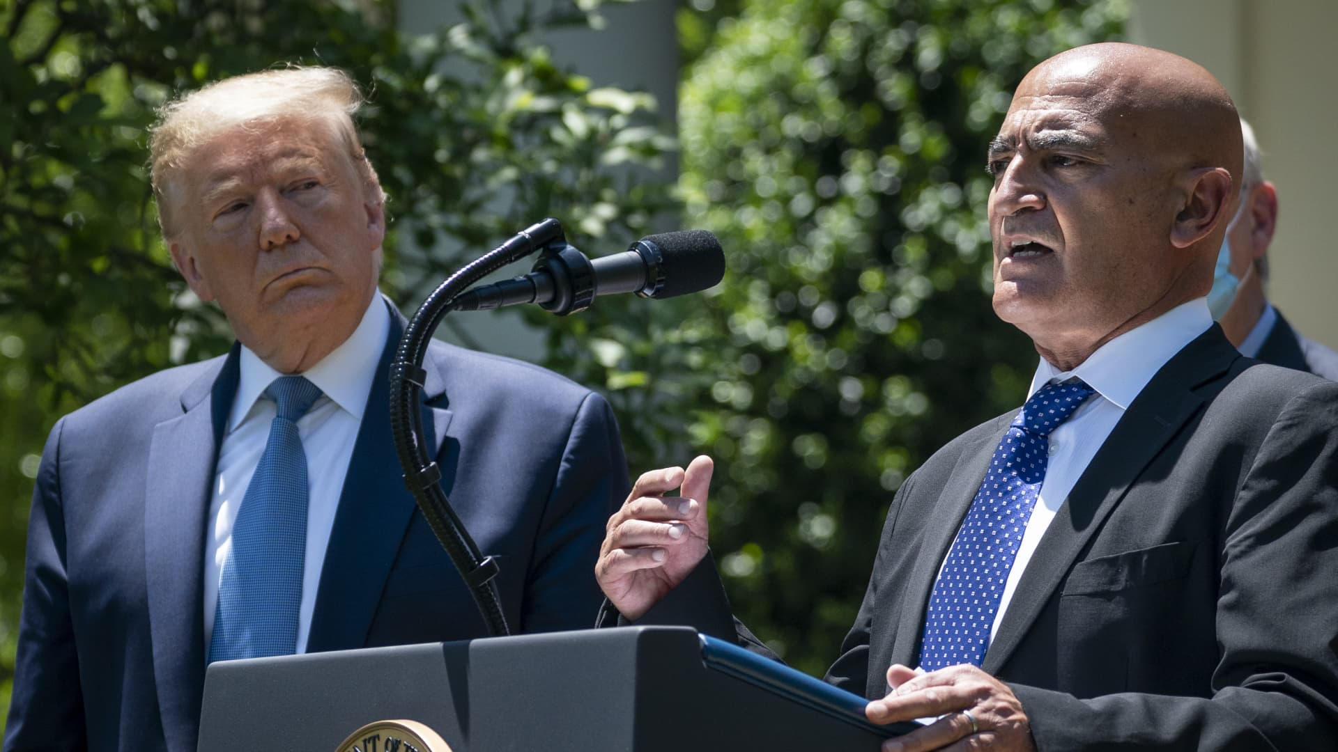 U.S. President Donald Trump listens as Moncef Slaoui, the former head of GlaxoSmithKlines vaccines division, speaks about coronavirus vaccine development in the Rose Garden of the White House on May 15, 2020 in Washington, DC.