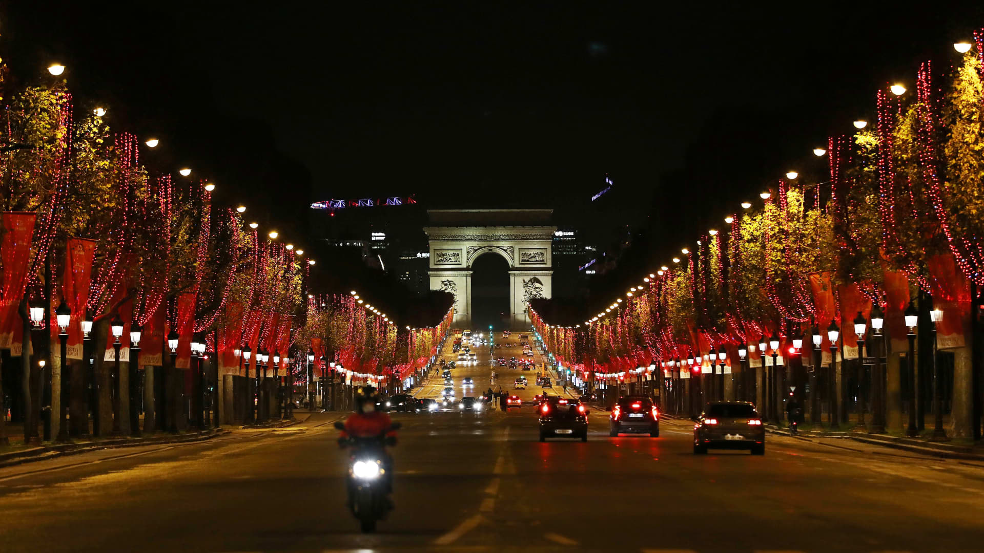 The Champs-Elysees Avenue and the Arc de Triomphe are seen after the Christmas illuminations were switched on in Paris, France, Nov. 22, 2020.