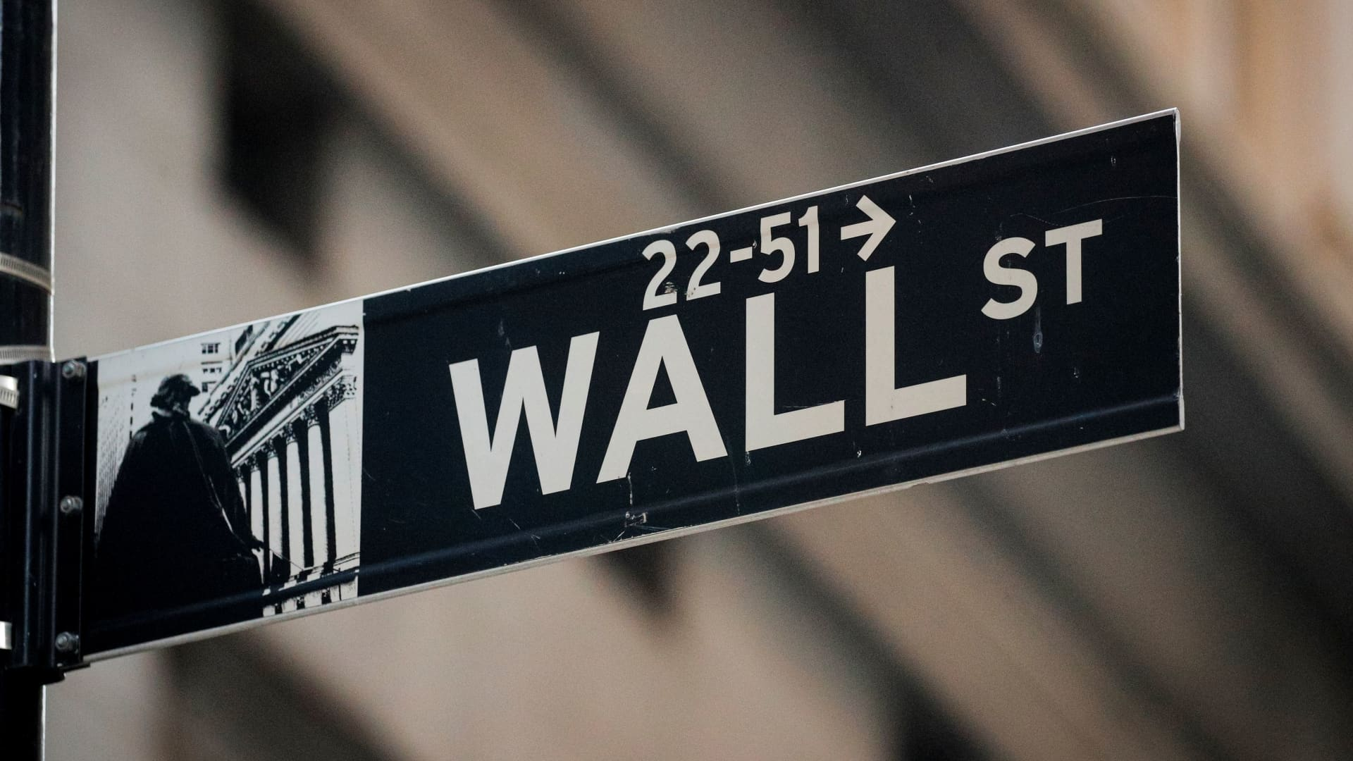 A Wall Street sign is seen near the New York Stock Exchange (NYSE) in the financial district in New York, November 24, 2020.