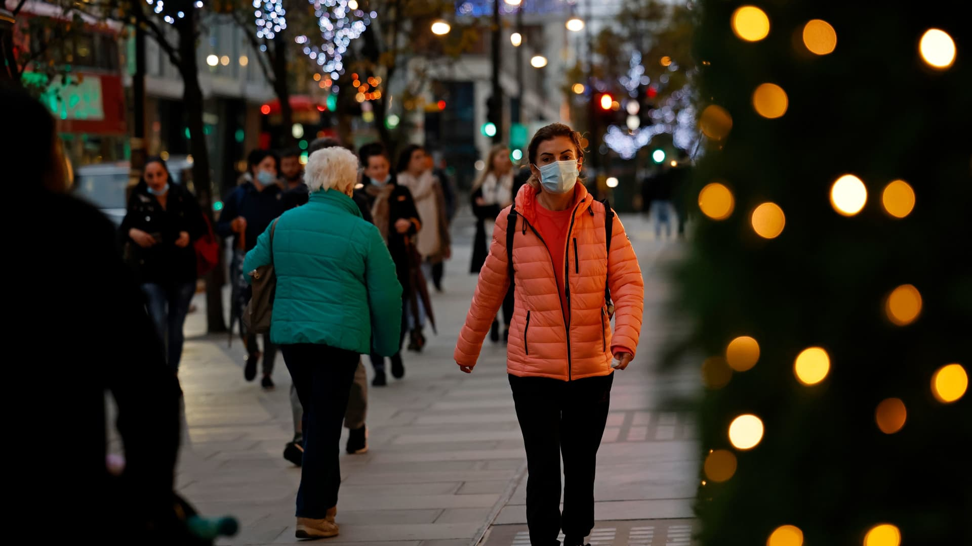 Pedestrians walk past Christmas lights on Oxford Street in central London on November 17, 2020.