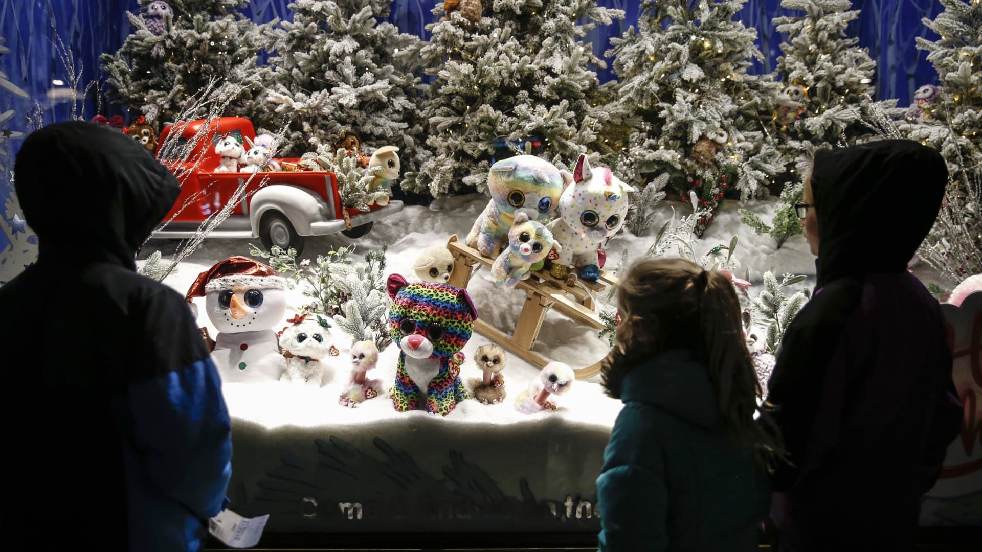 Children look at a window display at store on Regent Street in London.