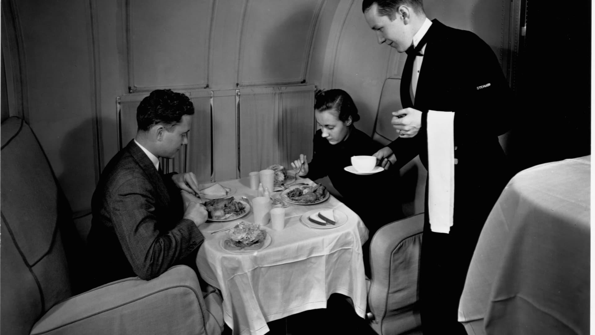 Passengers dine on a Pan Am Martin Clipper.