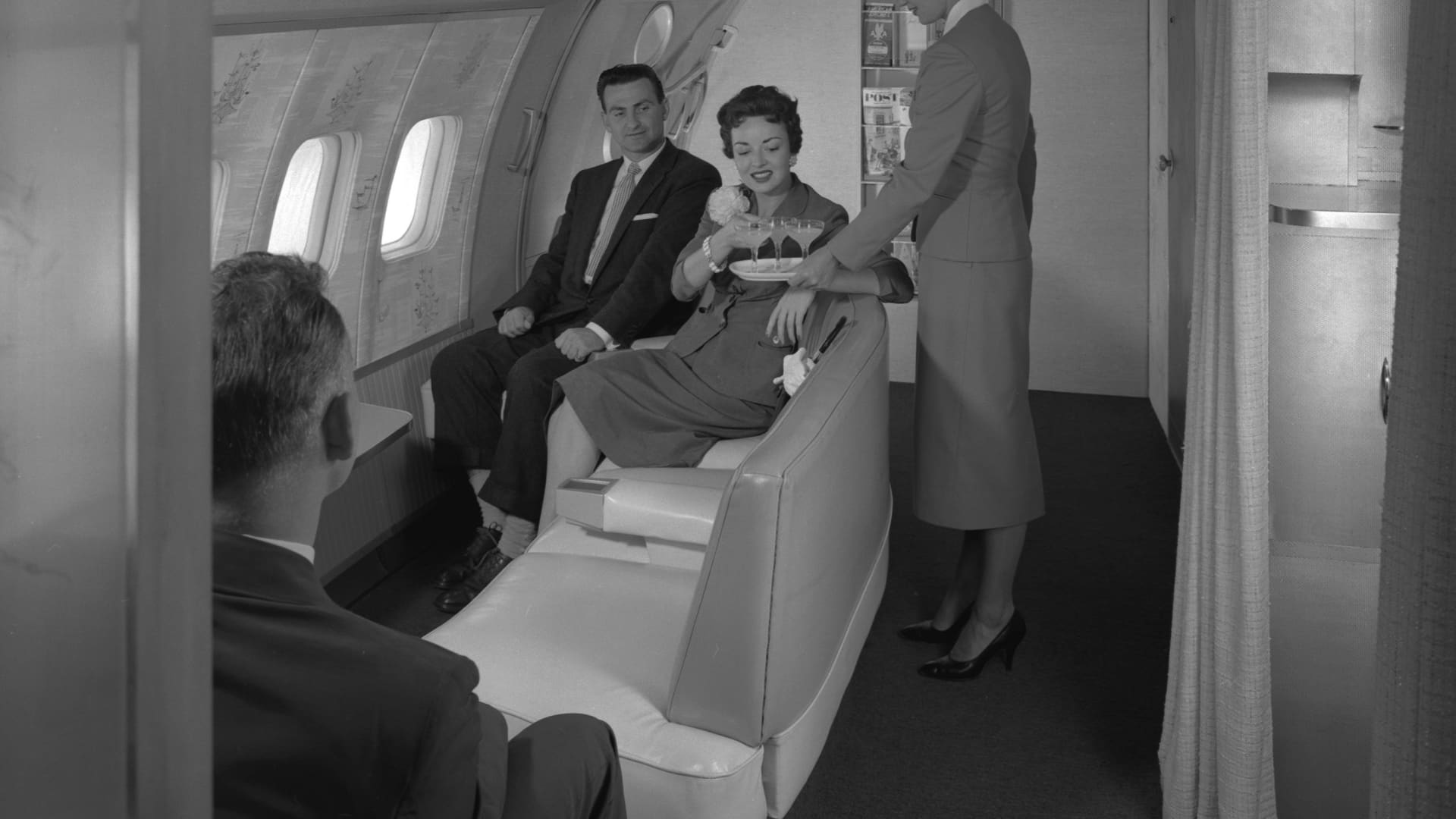 Passengers being served in the observation area of a Boeing 377 Stratocruiser.