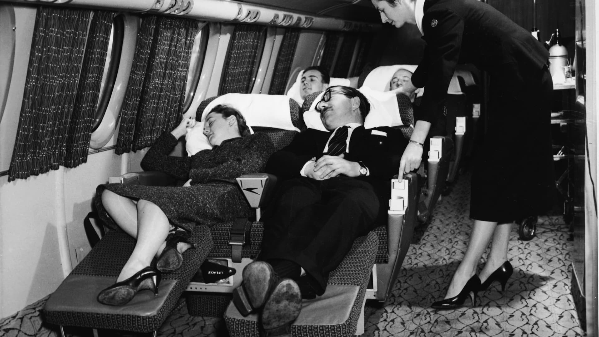 A first-class compartment of a commercial passenger plane in the 1950s.