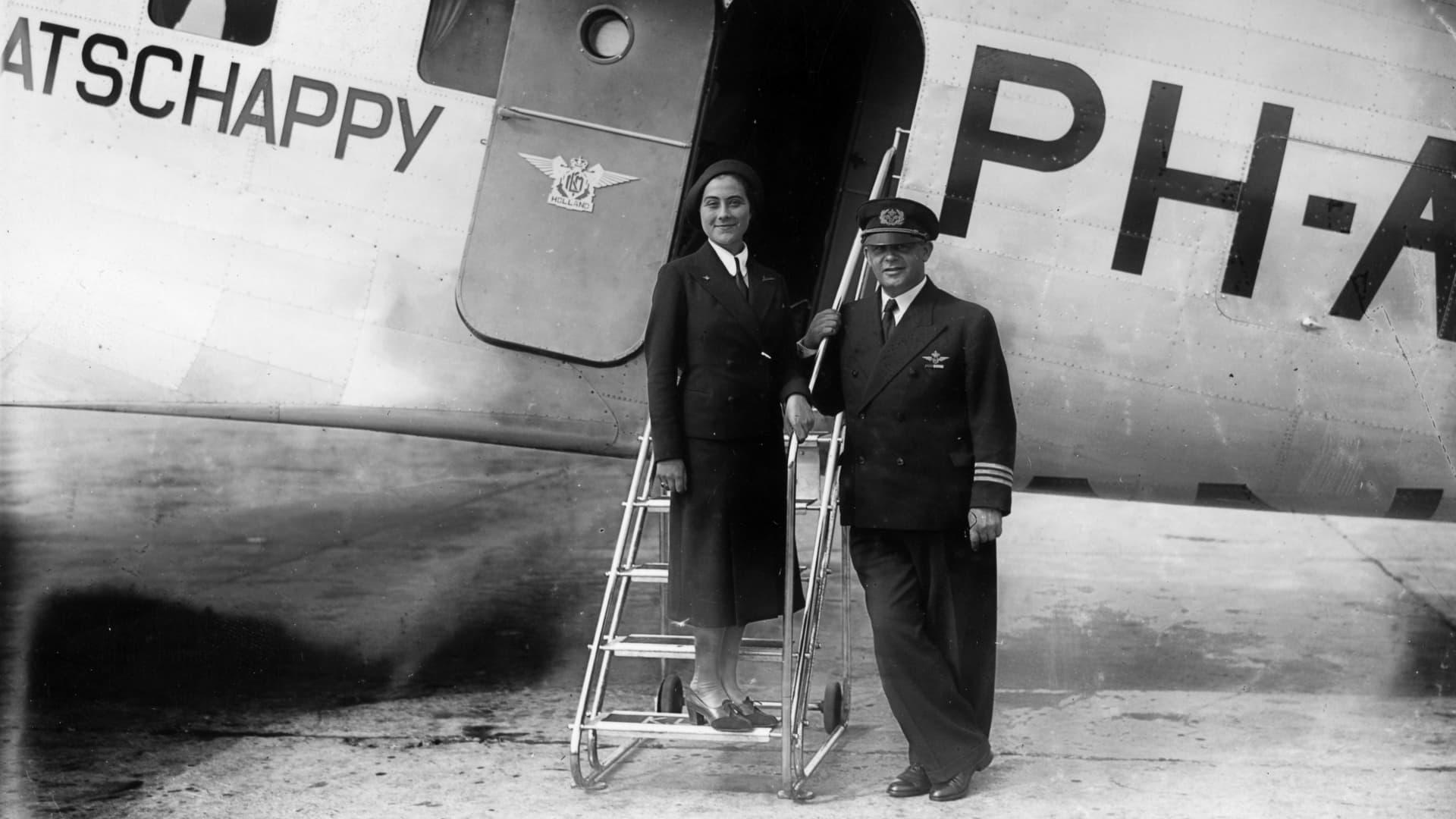 A KLM air hostess and pilot, circa 1935.