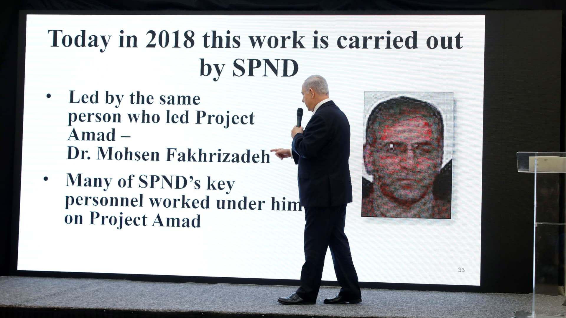 Israeli Prime Minister Benjamin Netanyahu points at a screen with an image of Iranian nuclear scientist Mohsen Fakhrizadeh during a news conference at the Ministry of Defence in Tel Aviv, Israel, April 30, 2018.