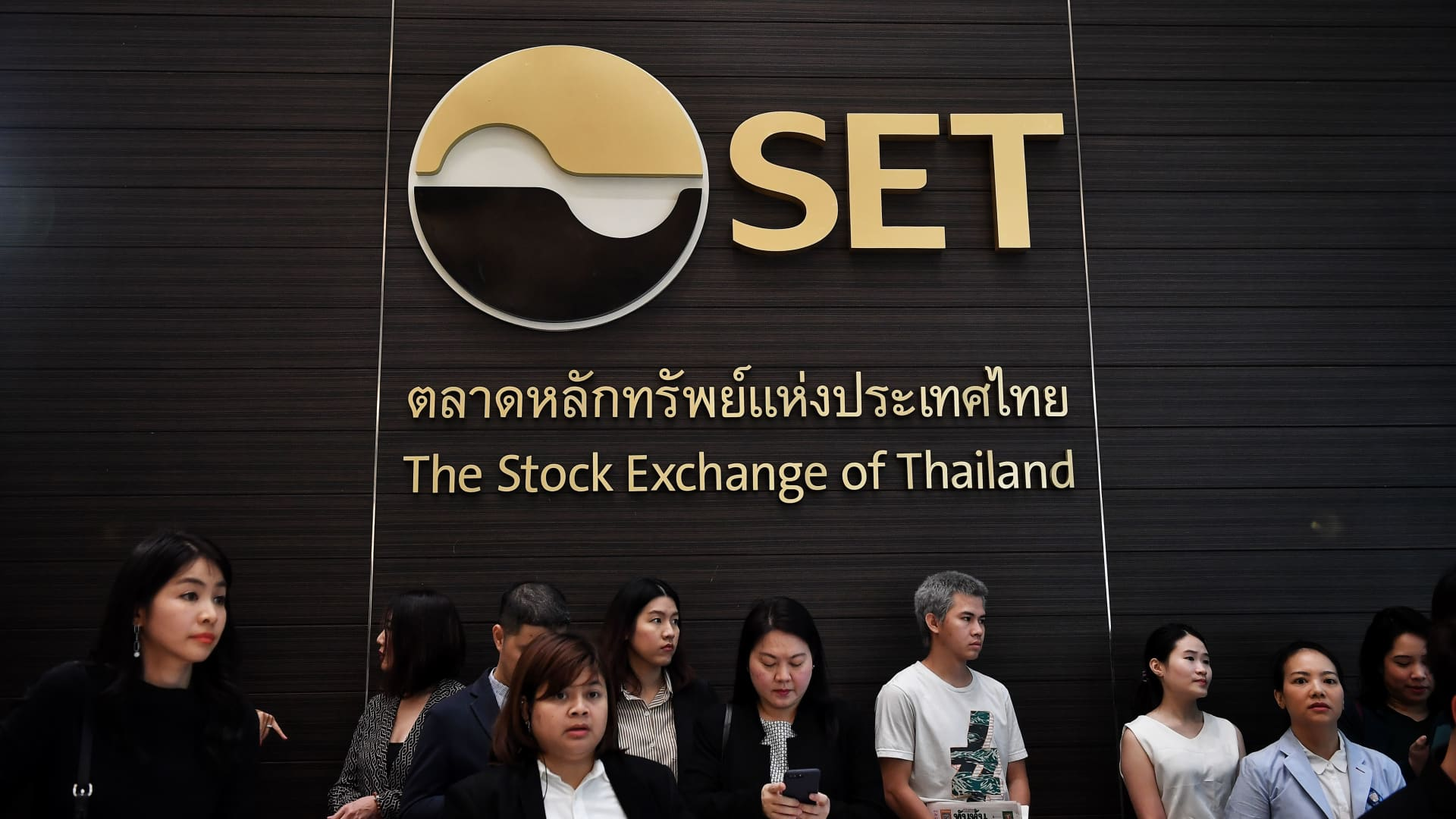 Attendees wait for Central Retail Corporation to start trading as Thailand's largest IPO ever at the Stock Exchange of Thailand in Bangkok on Feb. 20, 2020.