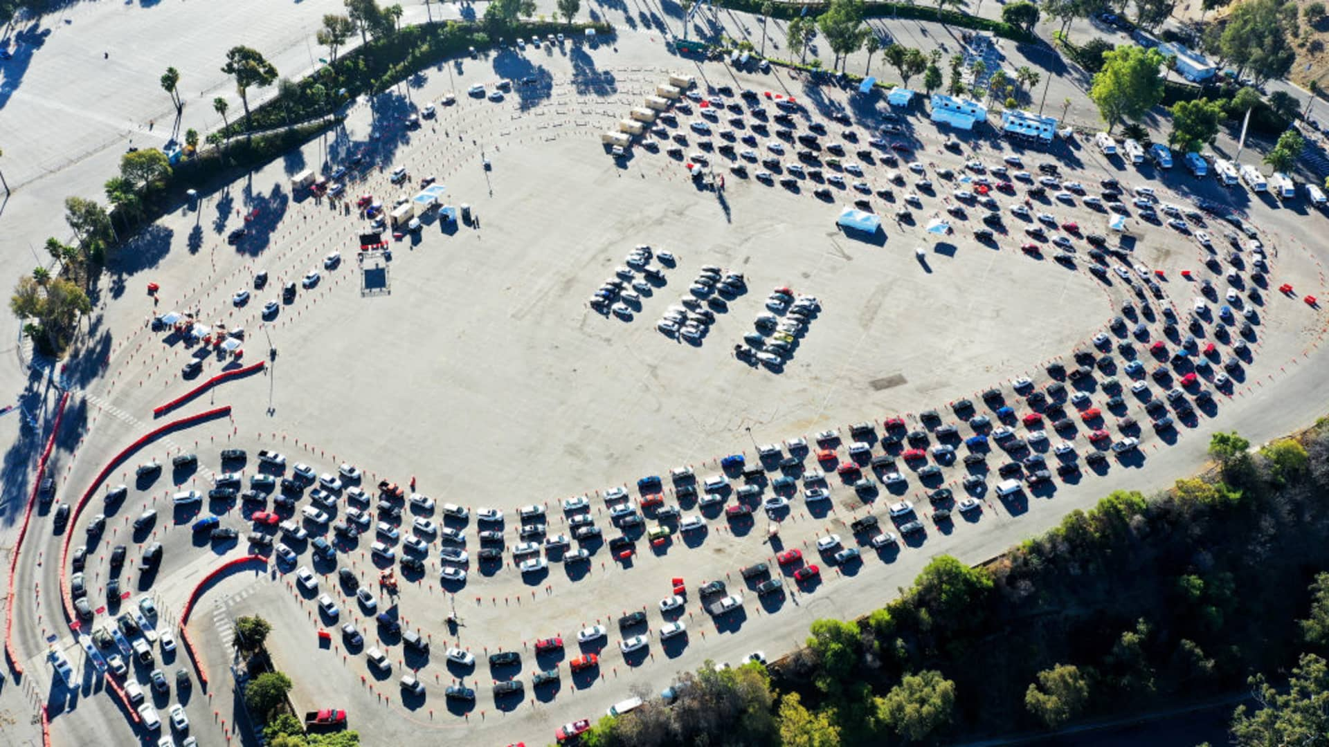 In an aerial view from a drone, cars are lined up at Dodger Stadium for COVID-19 testing on the Monday after Thanksgiving weekend on November 30, 2020 in Los Angeles, California.