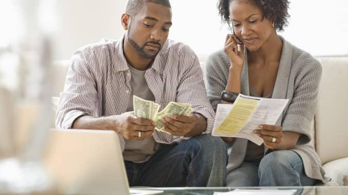black couple, paying bills, bills, money