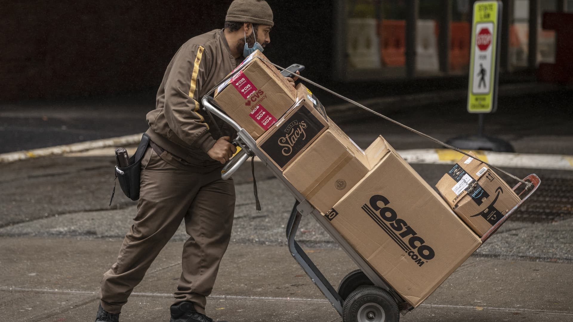 A United Parcel Service Inc. (UPS) driver delivers boxes in New York, U.S., on Tuesday, Oct. 13, 2020.