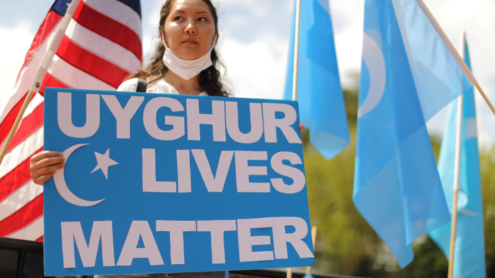 A protester outside the White House urges the United States to take action to stop the oppression of the Uyghur and other Turkic peoples, on August 14, 2020 in Washington, DC.