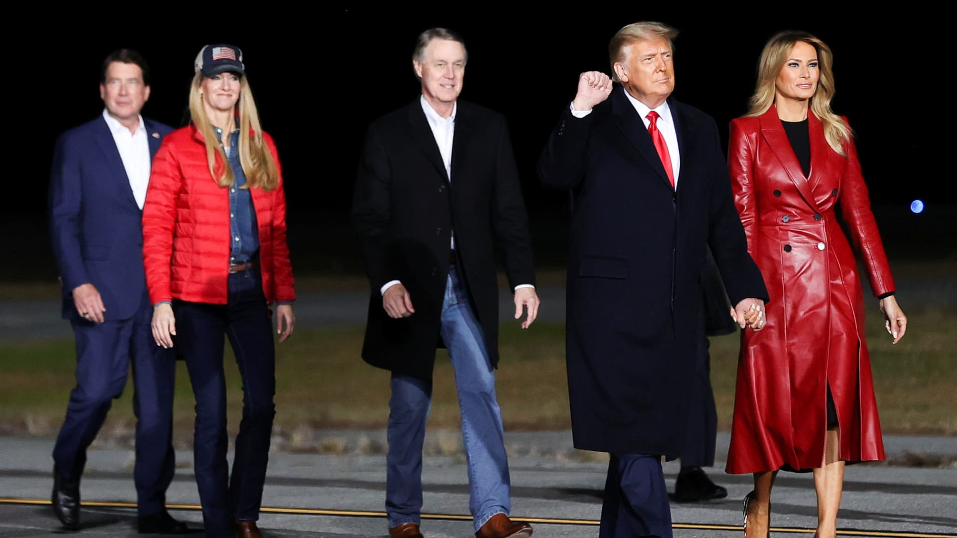 U.S. President Donald Trump, first lady Melania Trump and Republican U.S. senators David Perdue and Kelly Loeffler, arrive to attend a campaign rally, in Valdosta, Georgia, U.S., December 5, 2020.