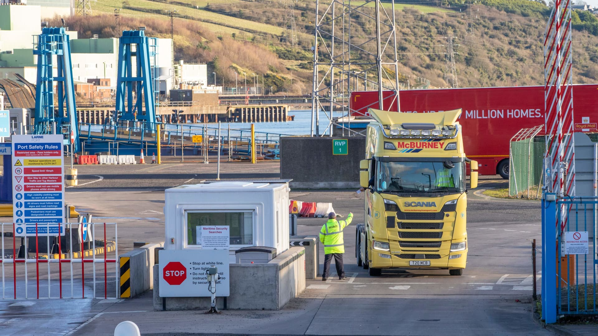 A lorry passes through security at the Port of Larne in Co Antrim, Northern Ireland on December 6, 2020.