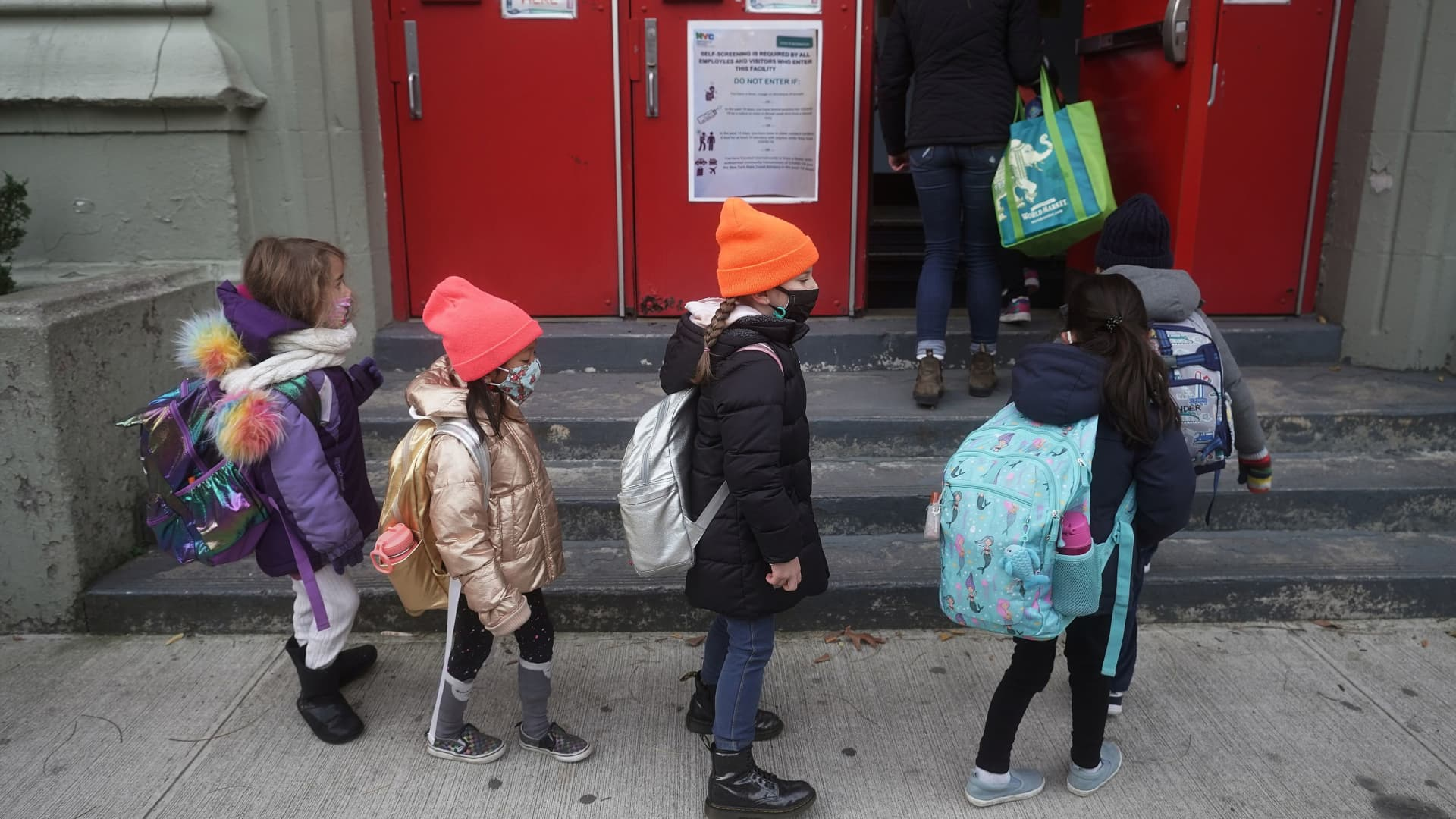 Children line up to attend class at PS 361 on the first day of a return to class during the coronavirus disease (COVID-19) pandemic in the Manhattan borough of New York City, New York, U.S., December 7, 2020.