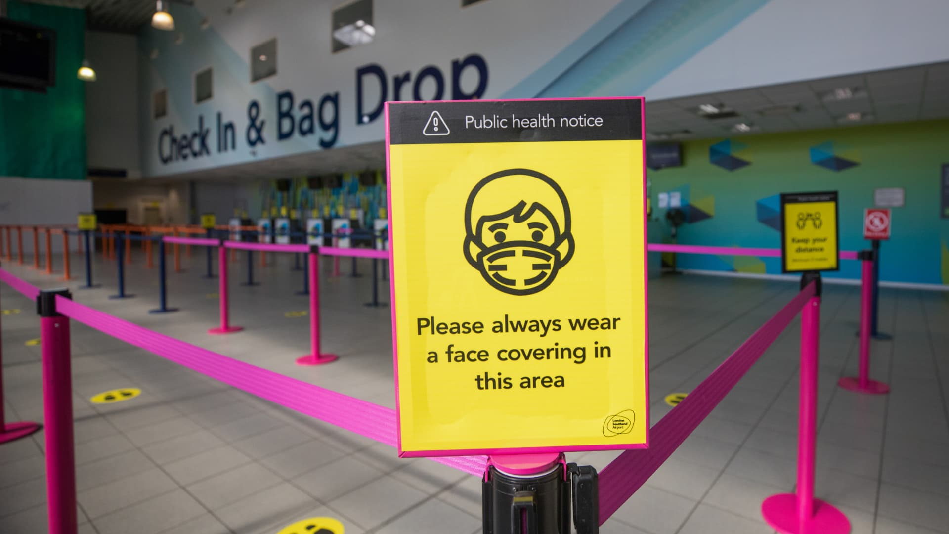 A public health notice stands at the entrance to the check in desks at London Southend Airport, part of the Stobart Group on Tuesday, July 7, 2020.