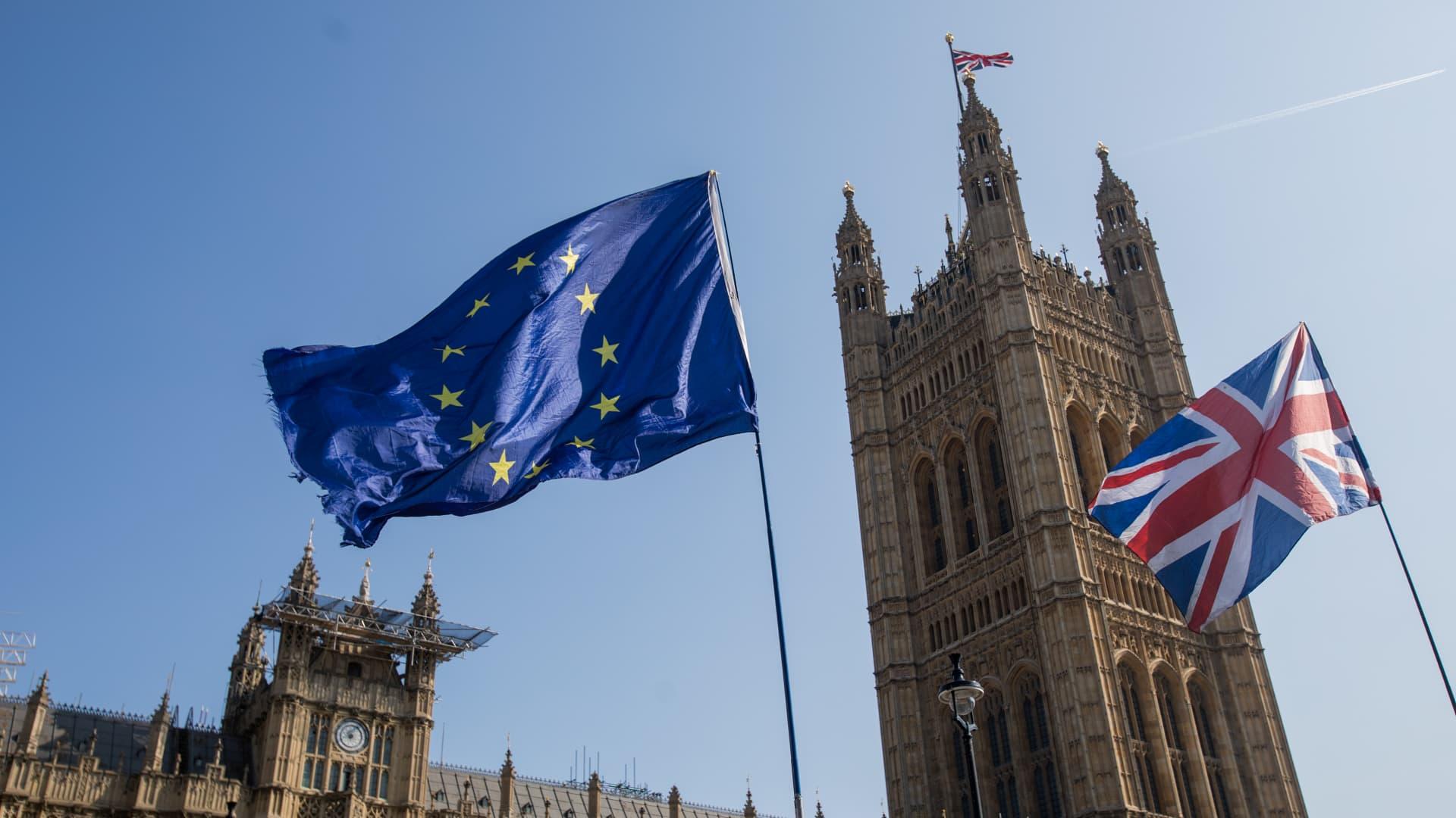 A European Union (EU) flies alongside a British Union flag, also known as a Union Jack in London.