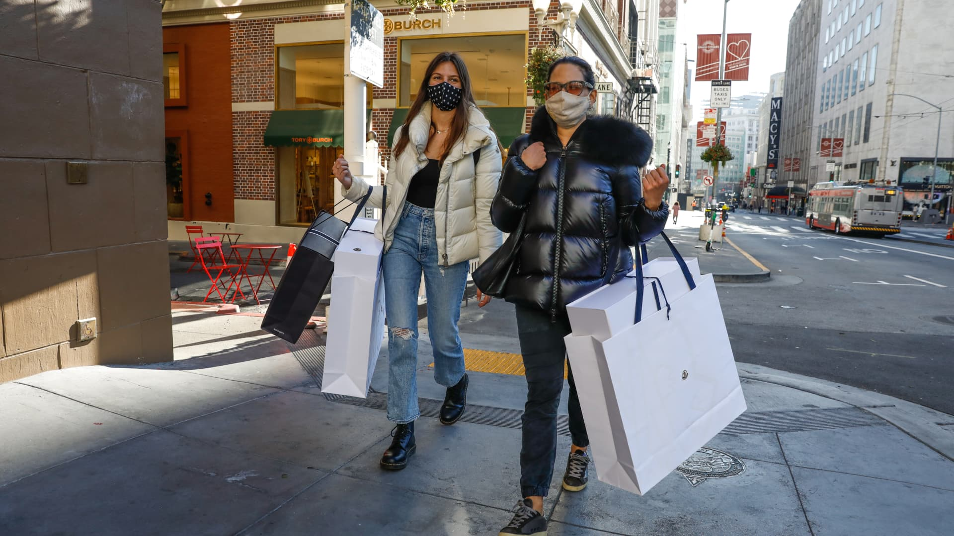 Wendy Reicher (right) and daughter Scarlett Reicher,18, (left) walk back to their car after going shopping in Union Square on Tuesday, Dec. 1, 2020 in San Francisco, California.