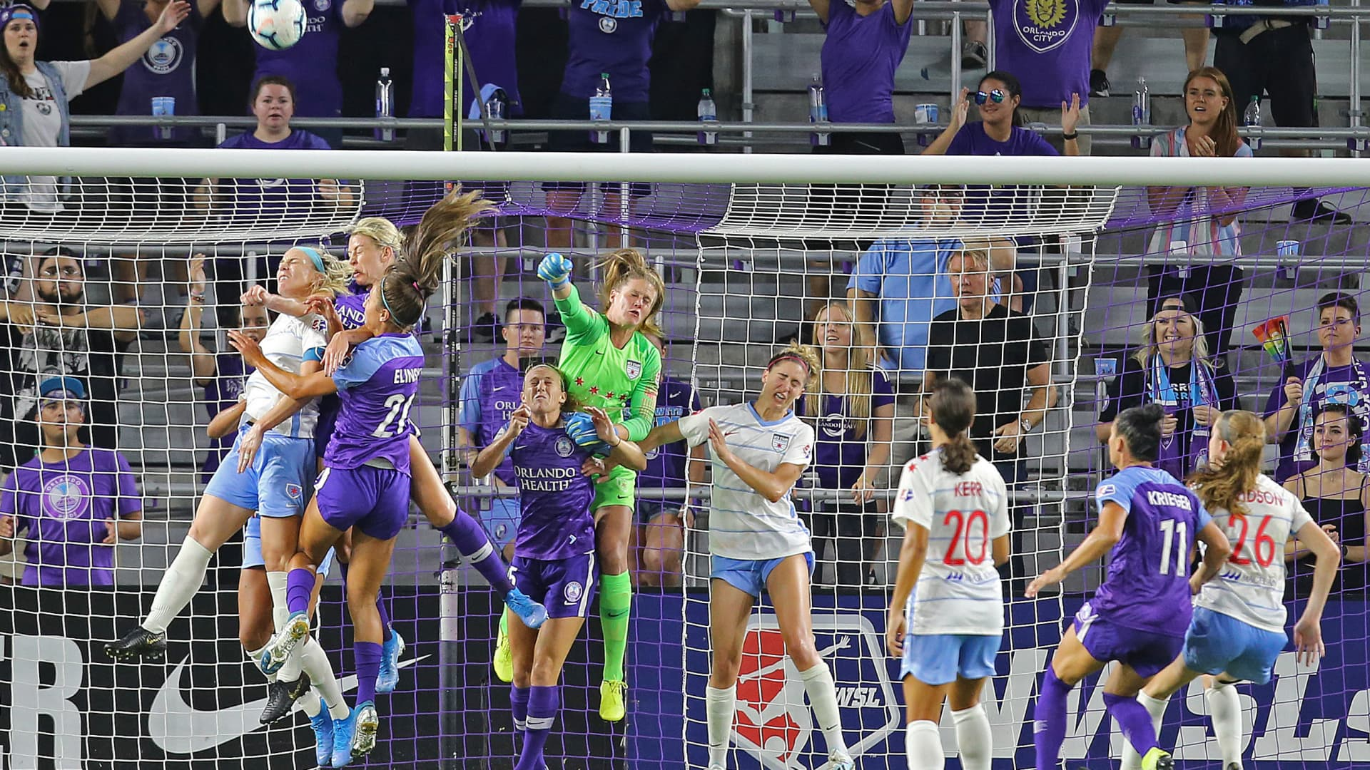 Alyssa Naeher #1 of Chicago Red Stars punches away a loose ball during a NWSL soccer match between the Chicago Red Stars and the Orlando Pride at Orlando City Stadium on September 11, 2019 in Orlando, Florida.