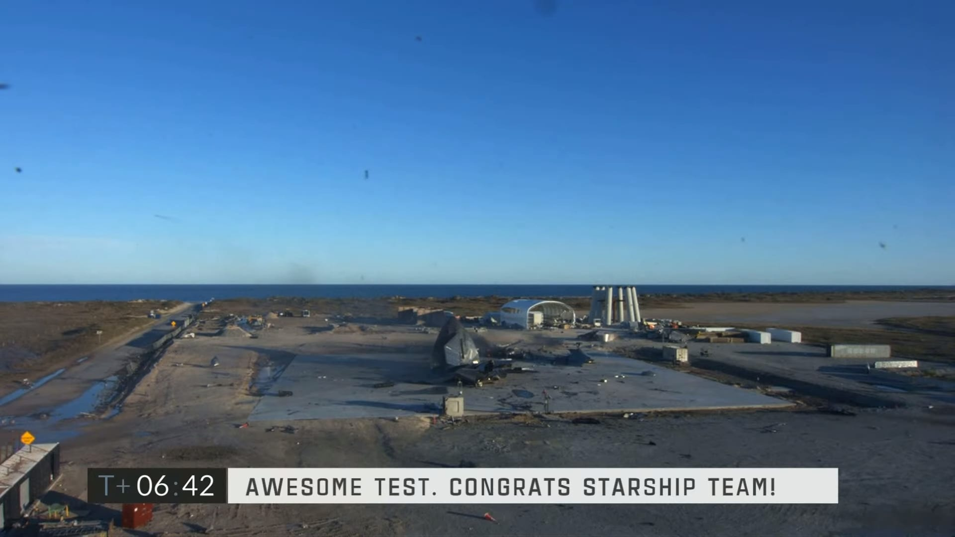 The remains of Starship SN8 on the landing pad after the flight test.