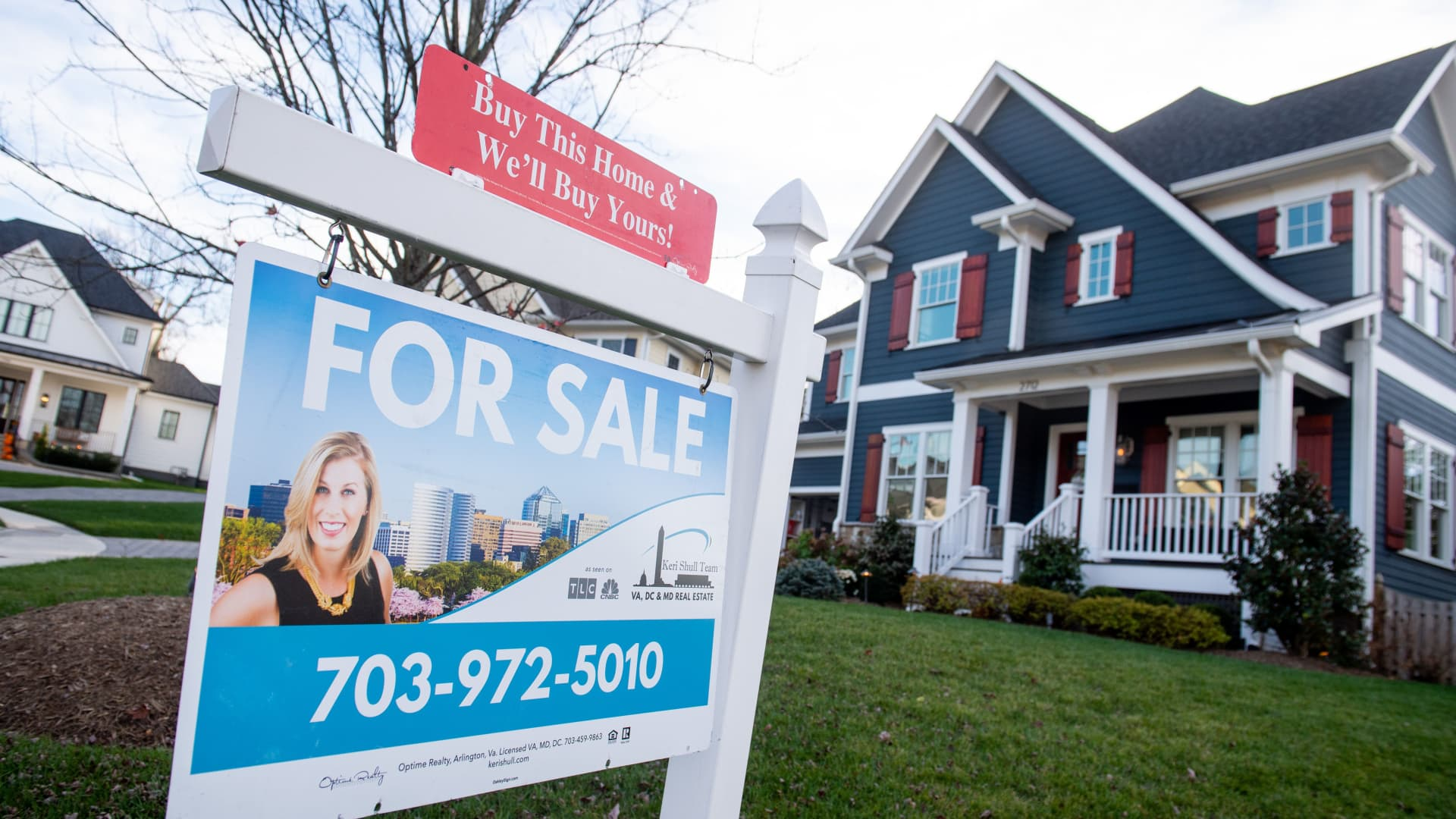 A house's real estate for sale sign is seen in front of a home in Arlington, Virginia, November 19, 2020.