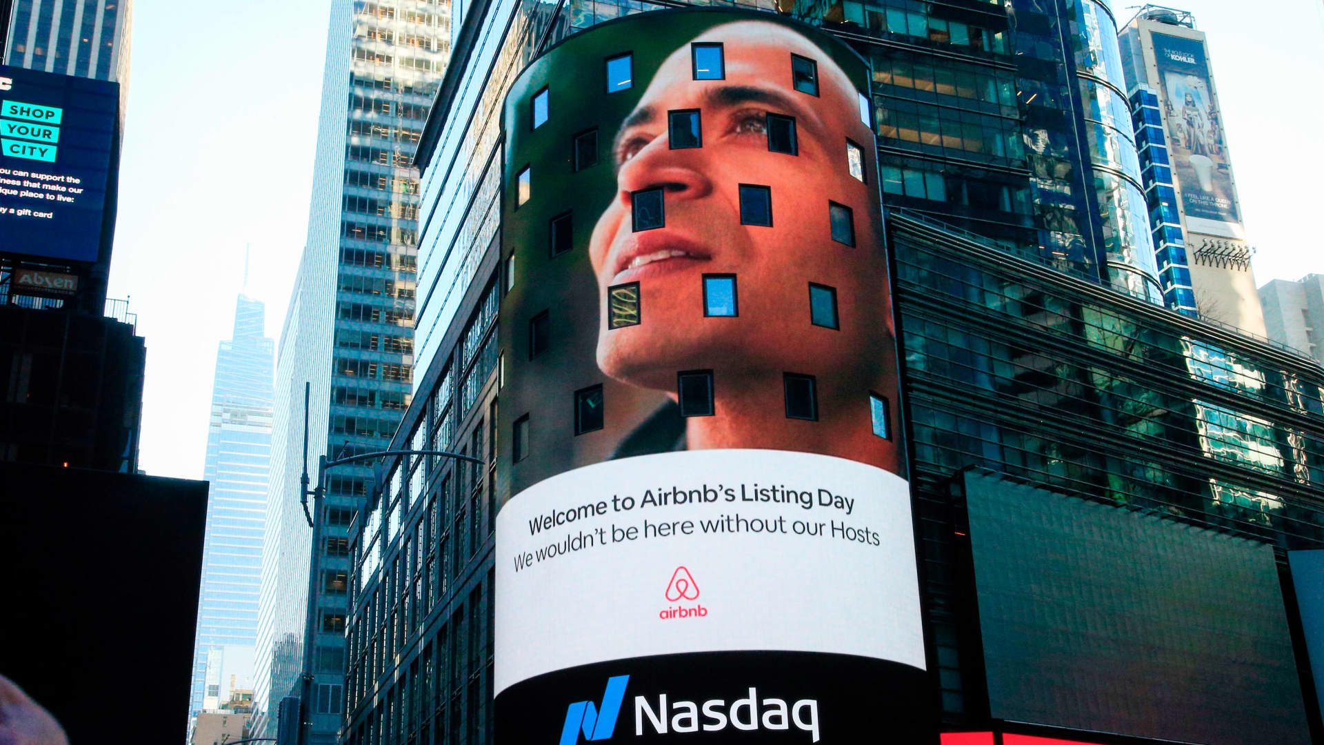 The Airbnb logo is displayed on the Nasdaq digital billboard in Times Square in New York on December 10, 2020.