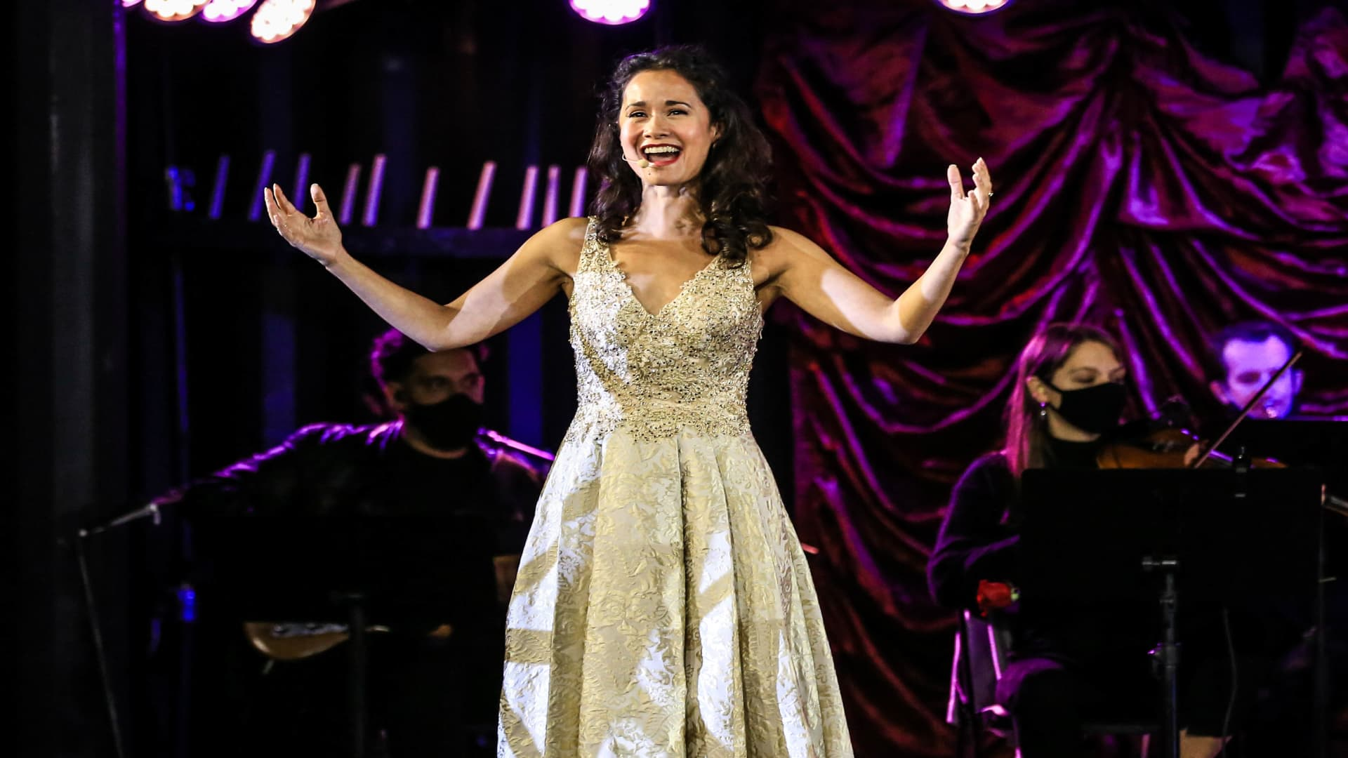 Ali Ewoldt performs in a drive-thru production of The Phantom of the Opera in Queens, New York.