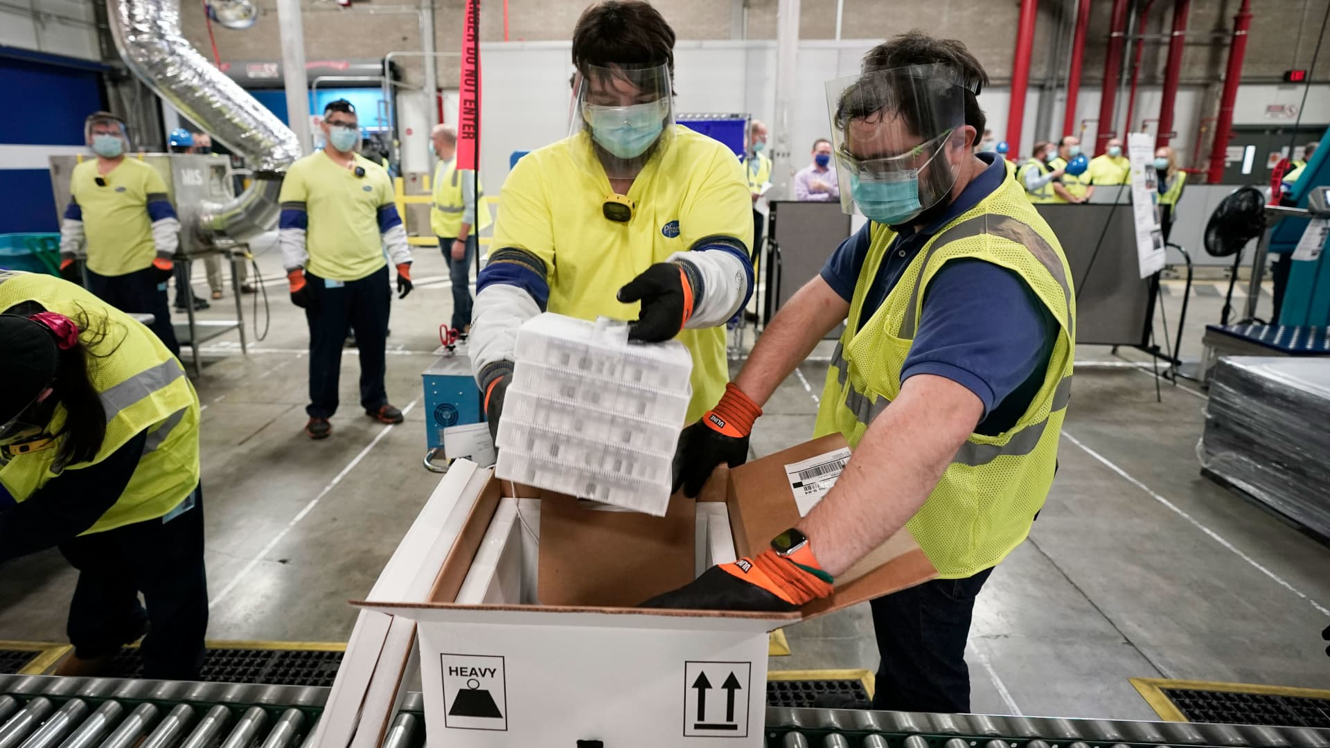 Boxes containing the Pfizer-BioNTech Covid vaccine are prepared to be shipped at the Pfizer Global Supply Kalamazoo manufacturing plant on December 13, 2020 in Portage, Michigan.