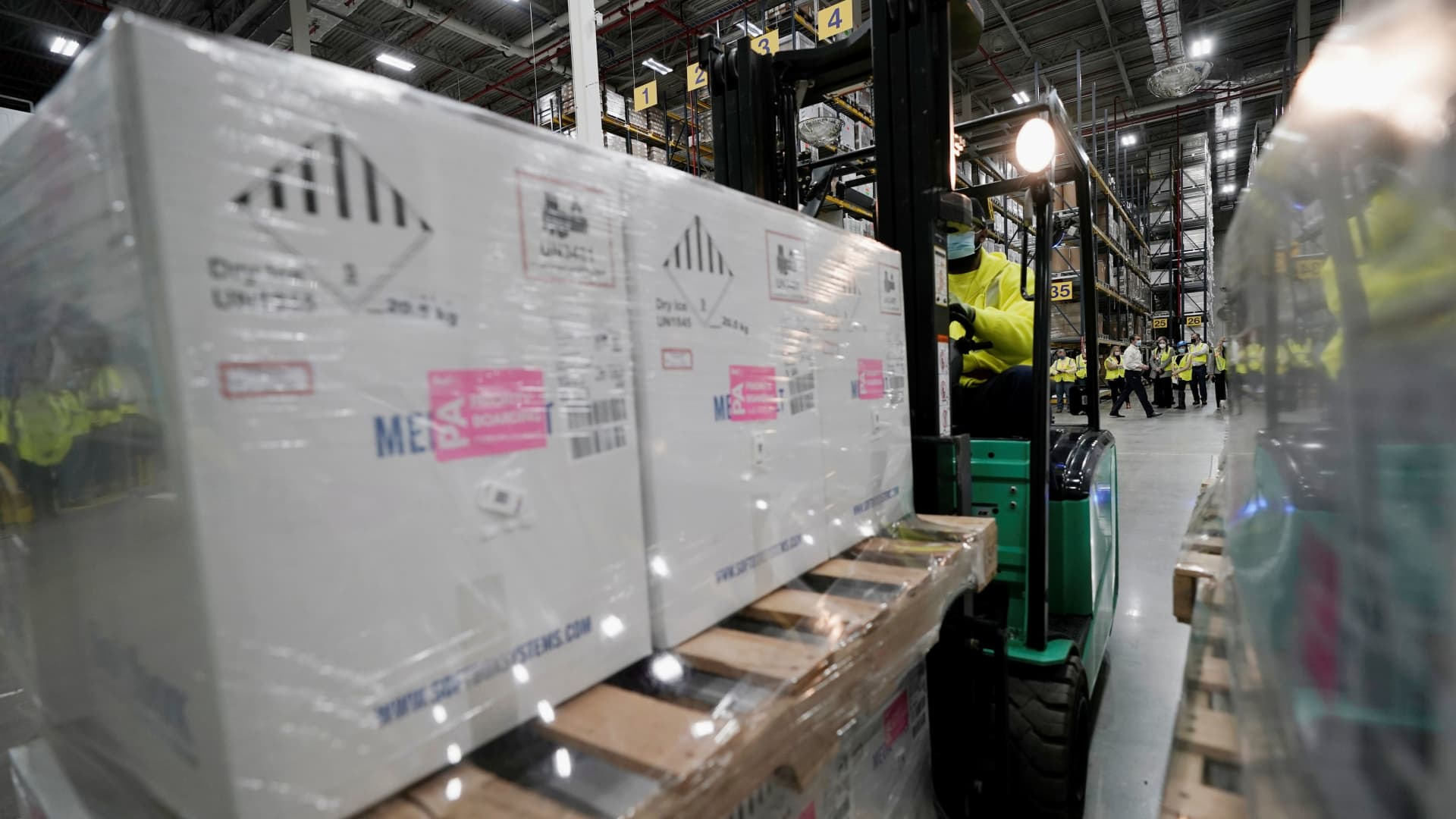 Boxes containing the Pfizer-BioNTech COVID-19 vaccine are prepared to be shipped at the Pfizer Global Supply Kalamazoo manufacturing plant in Portage, Michigan, U.S., December 13, 2020.