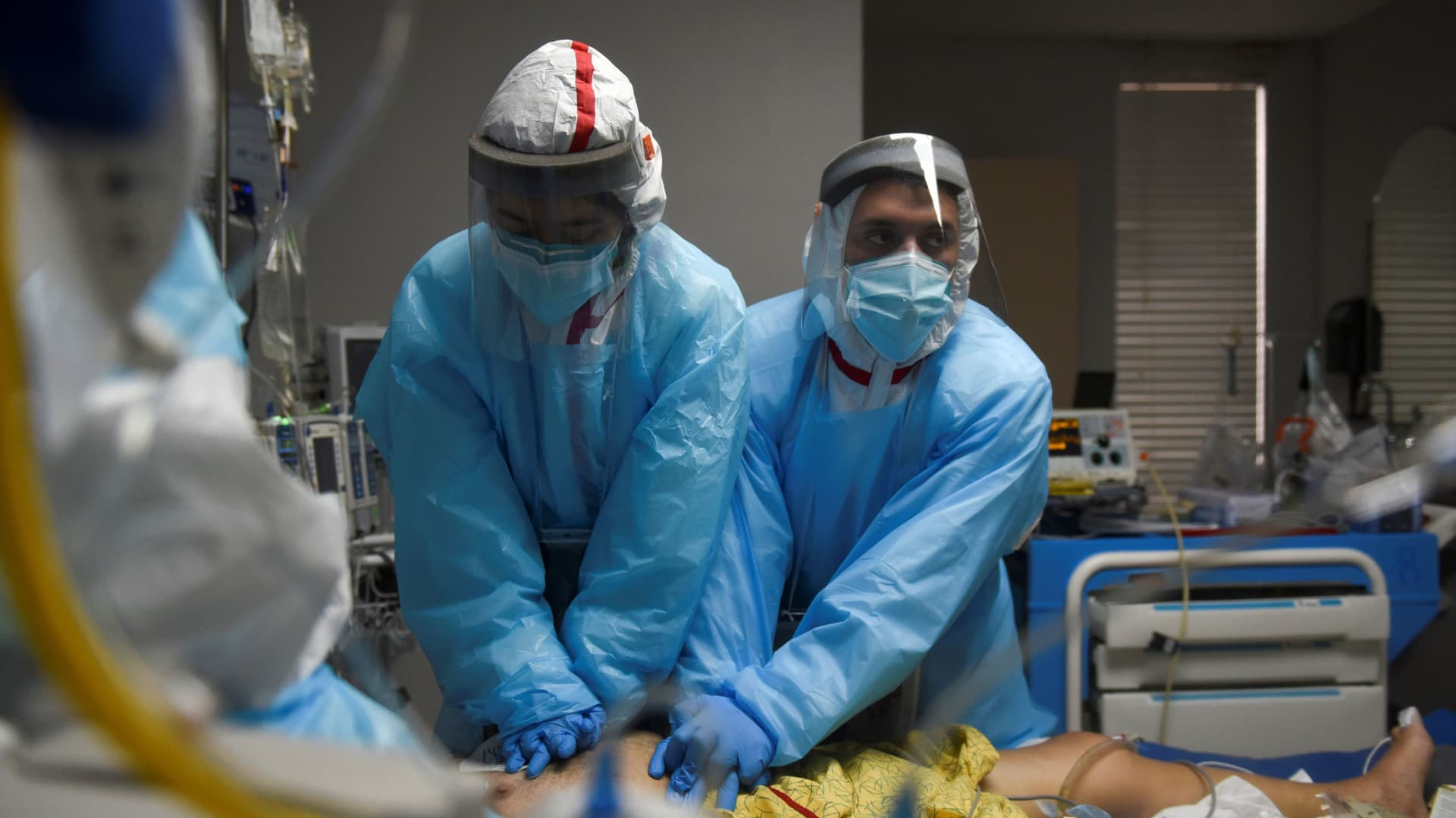 Healthcare personnel perform CPR on a patient inside a coronavirus disease (COVID-19) unit at United Memorial Medical Center as the United States nears 300,000 COVID-19 deaths, in Houston, Texas, U.S., December 12, 2020. Picture taken December 12, 2020.