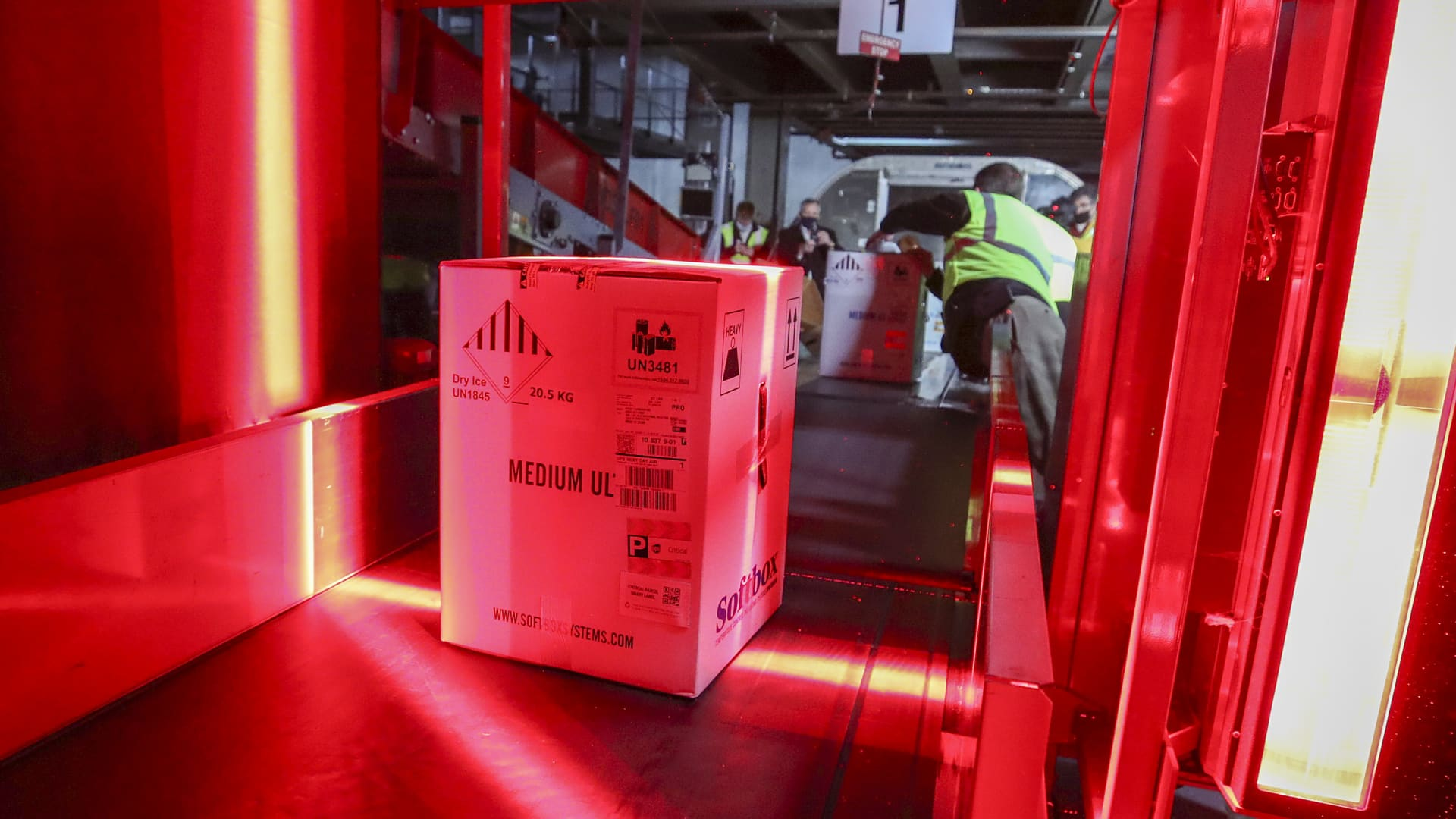 Boxes containing the first shipments of the Pfizer and BioNTech Covid vaccine are unloaded from air shipping containers and scanned at UPS Worldport on December 13, in Louisville, Kentucky.