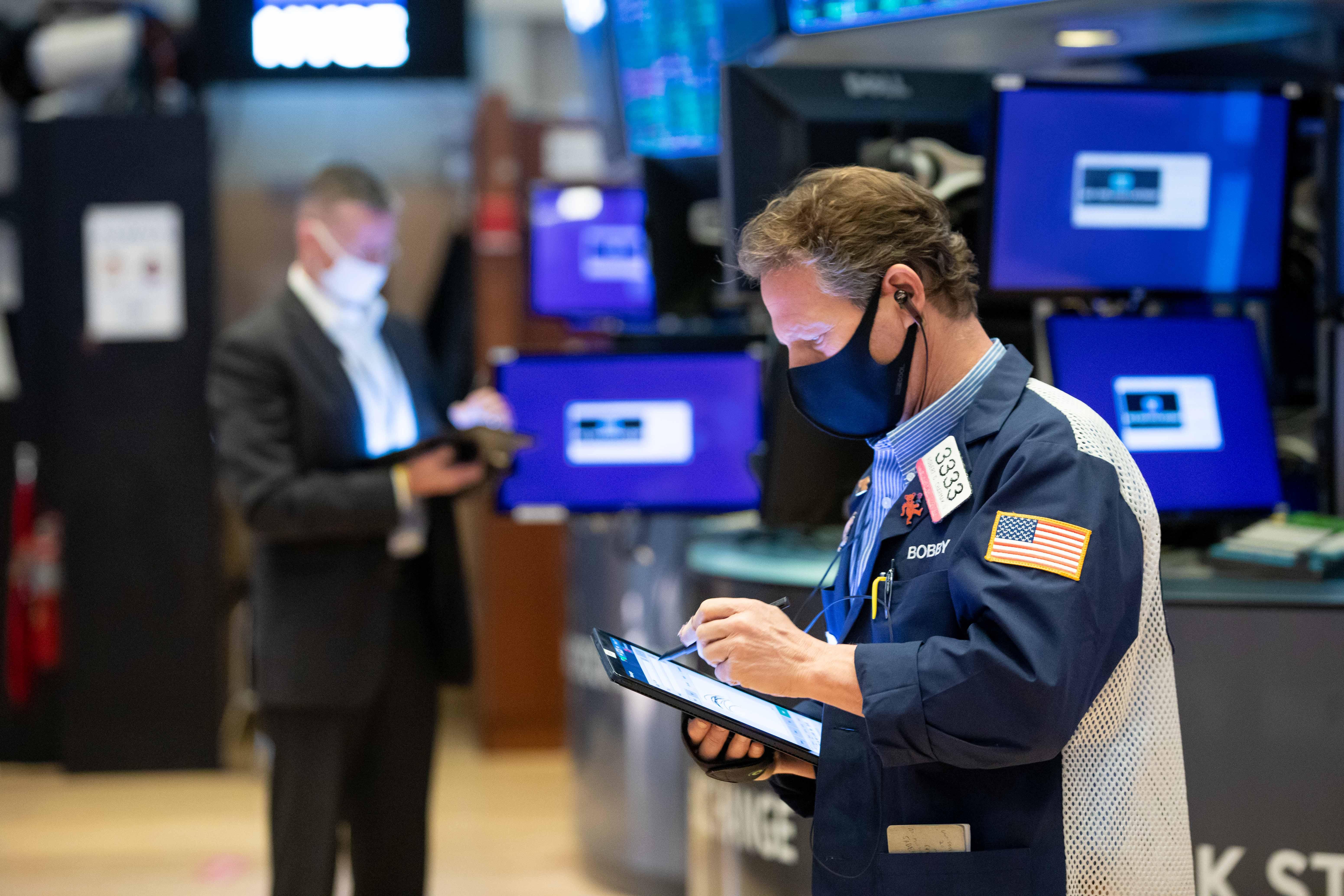 Stock futures slip as Wall Street kicks off the new year
