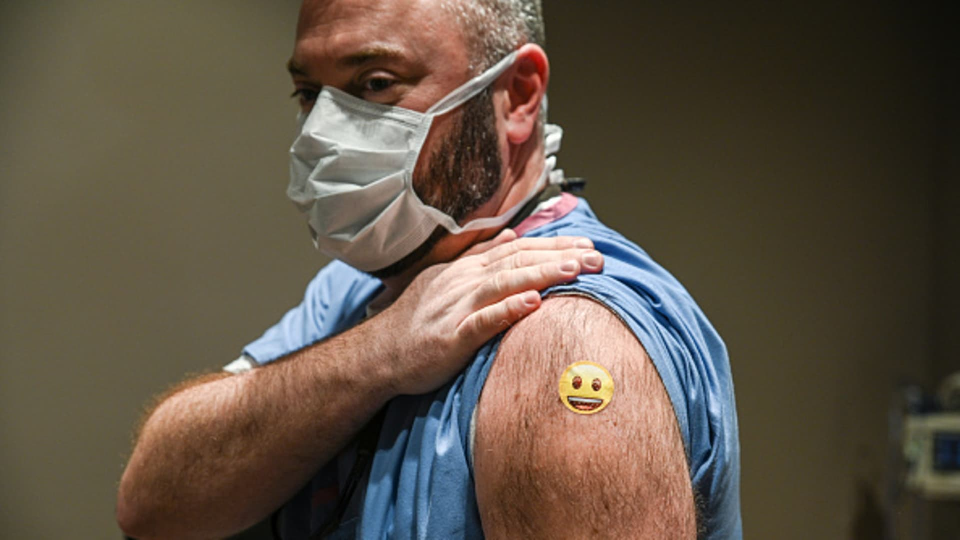 Dr. Jason Smith displays his bandage after being administered a COVID-19 vaccination at University of Louisville Hospital on December 14, 2020 in Louisville, Kentucky.