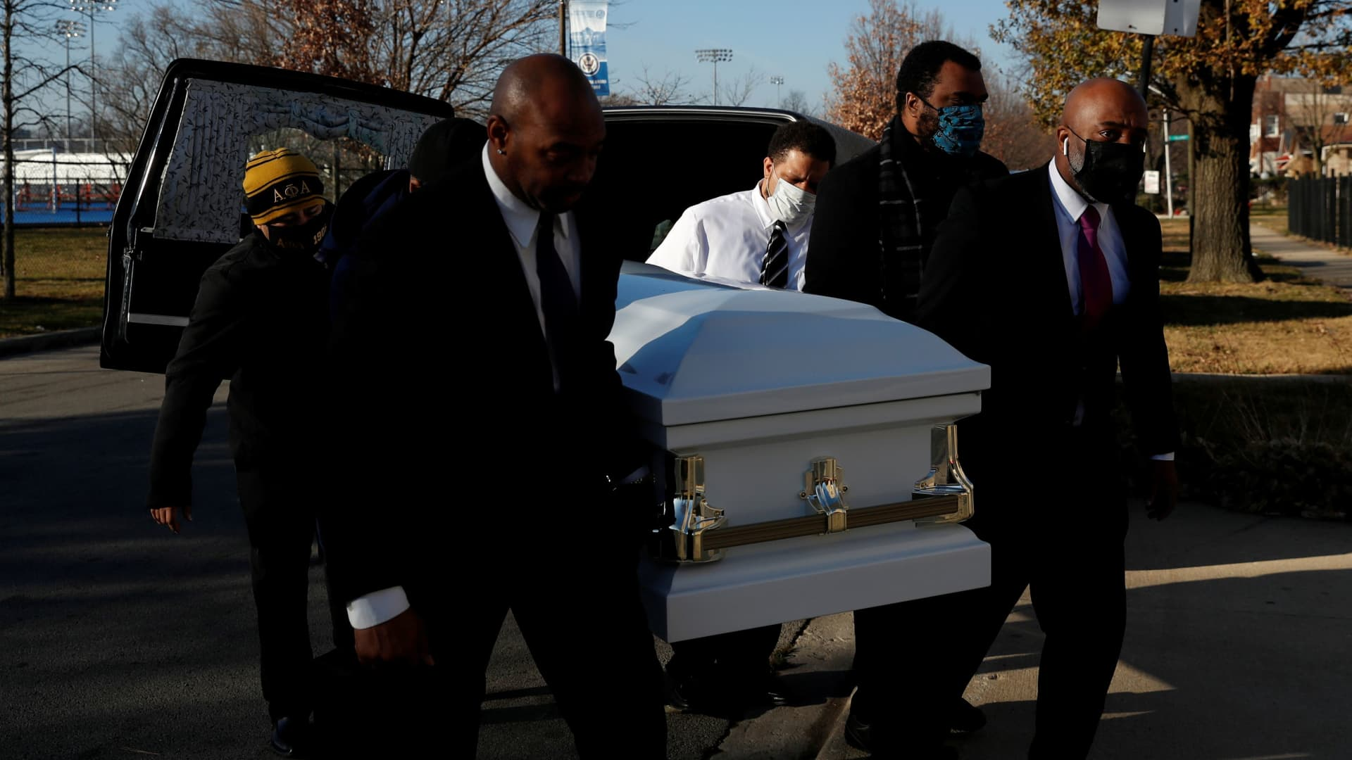 Sammie Michael Dent, Jr., the grandson of Florence Bolton, a coronavirus disease (COVID-19) positive patient that died on November 2nd at Roseland Community Hospital, carries her casket into Zion Evangelical Lutheran Church on the South Side of Chicago, Illinois, U.S., December 9, 2020.