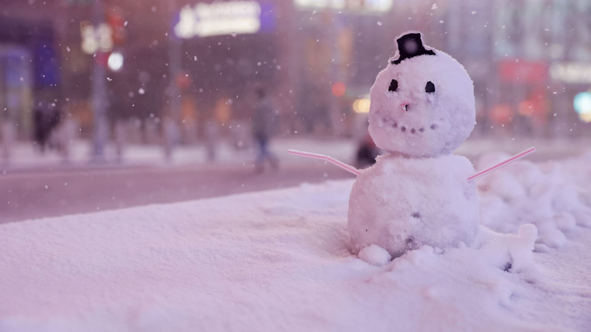 A snowman is seen as snow begins to fall in Times Square during a Nor'easter, during the coronavirus disease (COVID-19) pandemic in the Manhattan borough of New York City, New York, U.S., December 16, 2020.