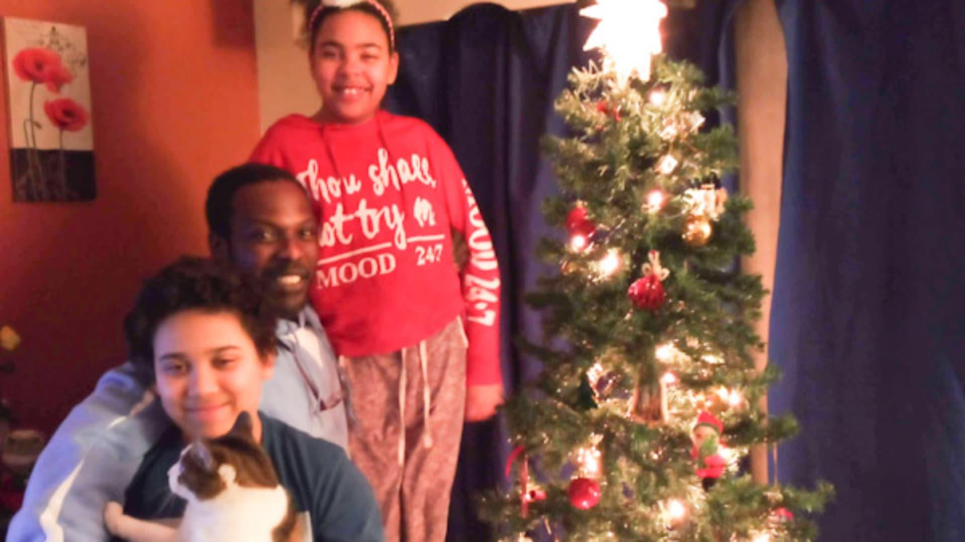 Ilene Toney's children, Izzac and Lillyana, and her fiance, Gerald Bright.