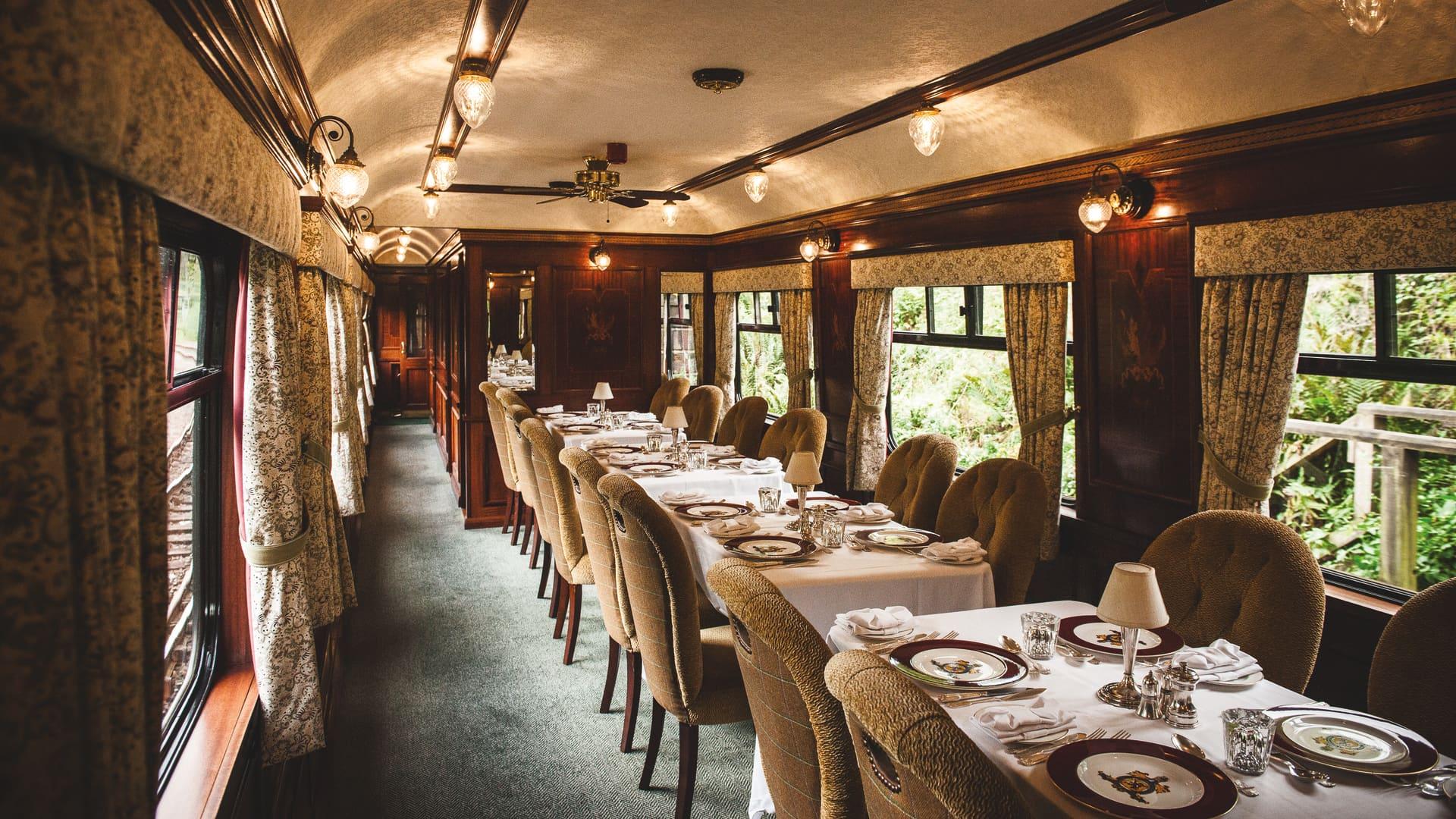 The mahogany-paneled dining cars on the Belmond Royal Scotsman.