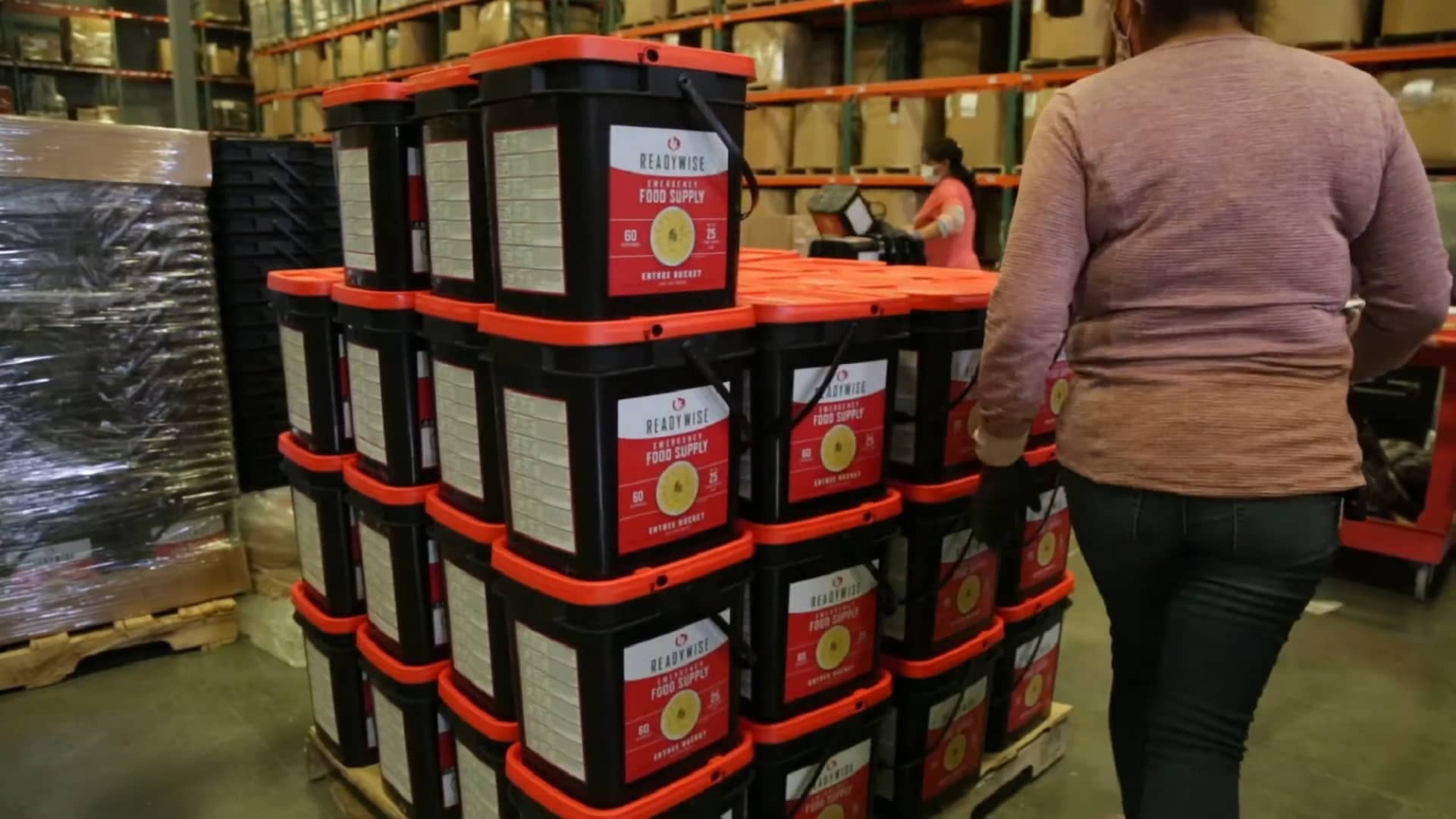 A pallet of ReadyWise emergency food supply buckets, each containing 60 servings of food with a 25-year shelf life.