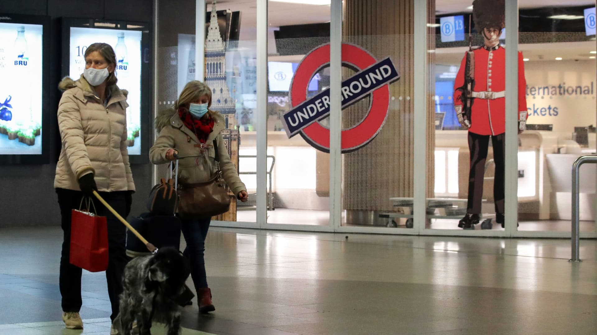 People walk past the closed entrance of the Eurostar terminal at Brussels South railway station after Britain's European neighbors began closing their doors to travelers from the United Kingdom amid alarm about a rapidly spreading strain of coronavirus, in Brussels, Belgium December 21, 2020.
