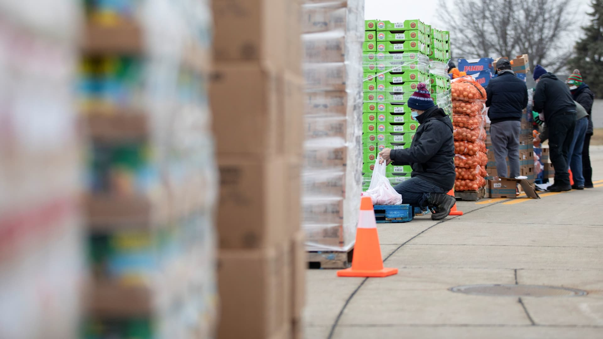 Volunteers from Forgotten Harvest food bank help sort goods to distribute during a mobile food pantry ahead of Christmas, amid the coronavirus disease (COVID-19) pandemic in Warren, Michigan, U.S., December 21, 2020.