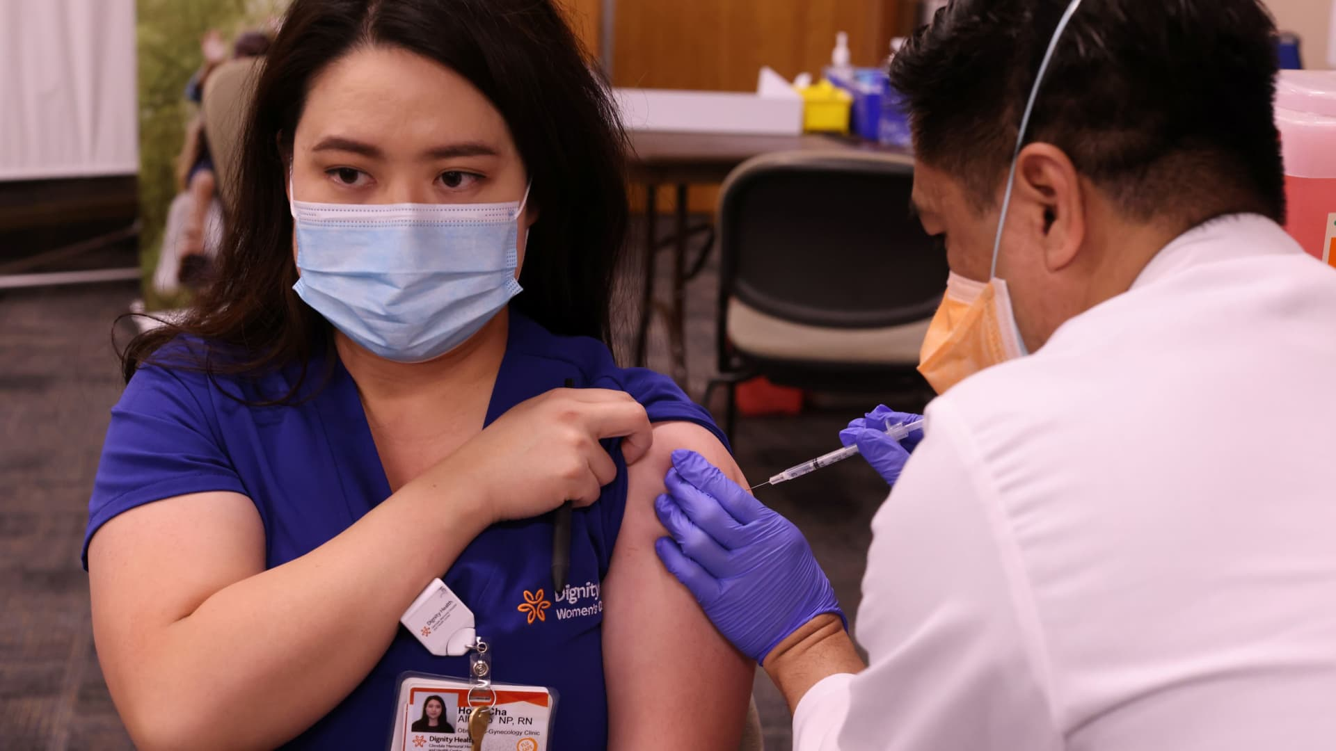 Nurse practitioner Hope Alfonso, 34, is given the Pfizer coronavirus disease (COVID-19) vaccine at Dignity Health Glendale Memorial Hospital and Health Center in Glendale, California, December 17, 2020.