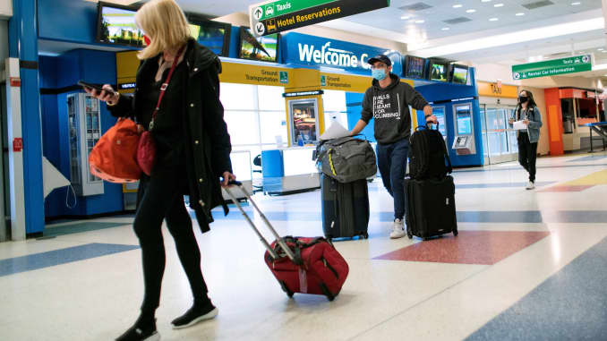 Passengers arrive on a flight from London amid new restrictions to prevent the spread of coronavirus disease (COVID-19) at JFK International Airport in New York City, U.S., December 21, 2020.