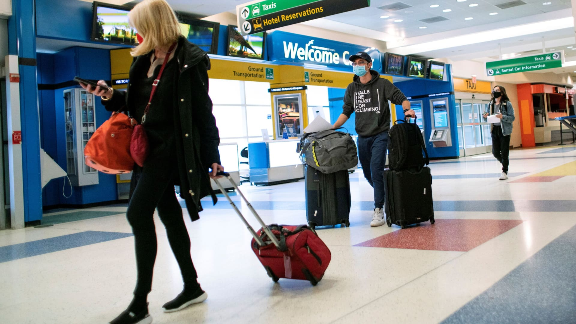 Passengers arrive on a flight from London amid new restrictions to prevent the spread of coronavirus disease (COVID-19) at JFK International Airport in New York, December 21, 2020.