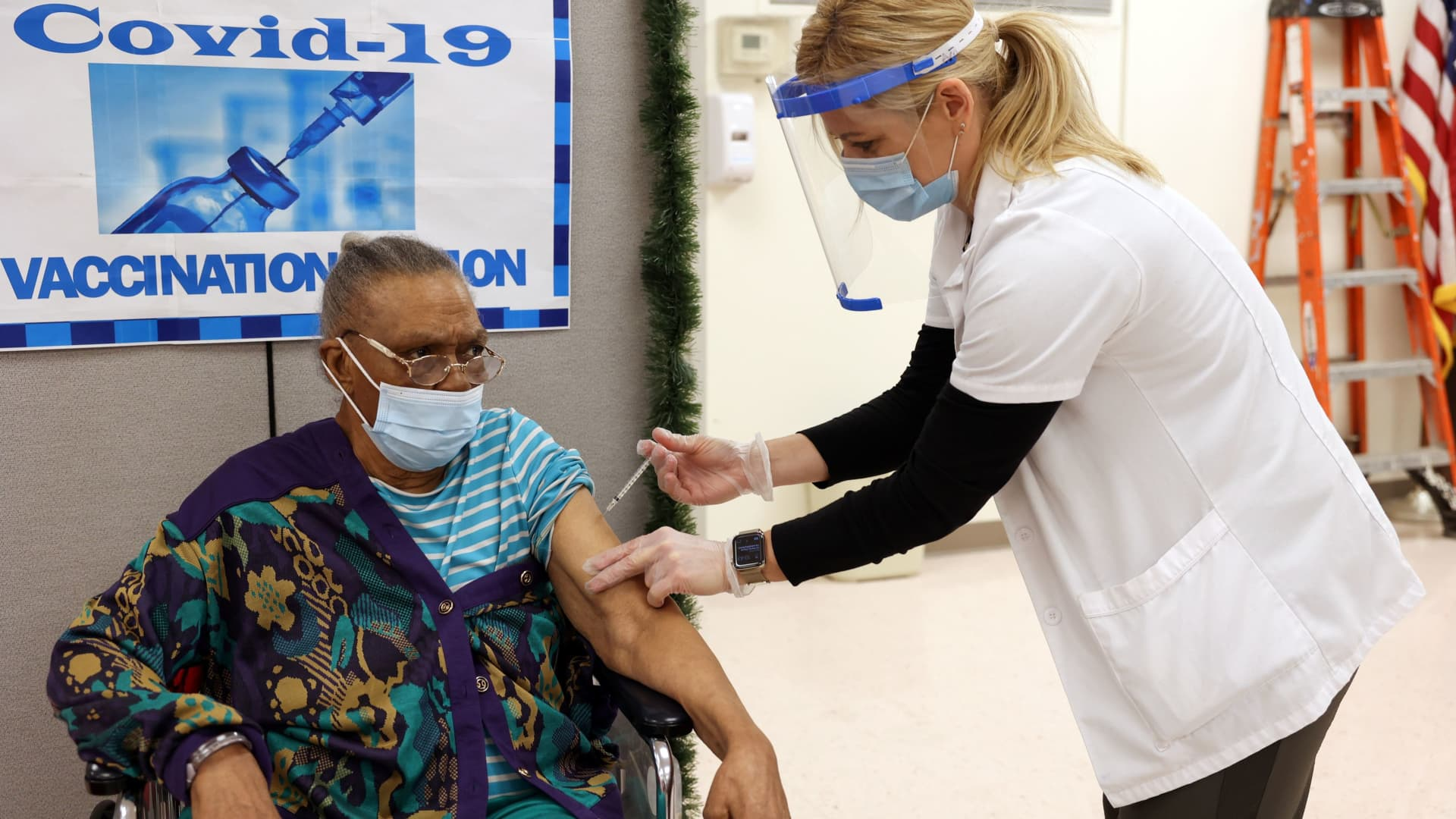 Ina Siler, a patient at Crown Heights Center for Nursing and Rehabilitation, a nursing home facility, receives the Pfizer-BioNTech coronavirus disease (COVID-19) vaccine from Walgreens pharmacist Annette Marshall, in Brooklyn, New York, December 22, 2020.