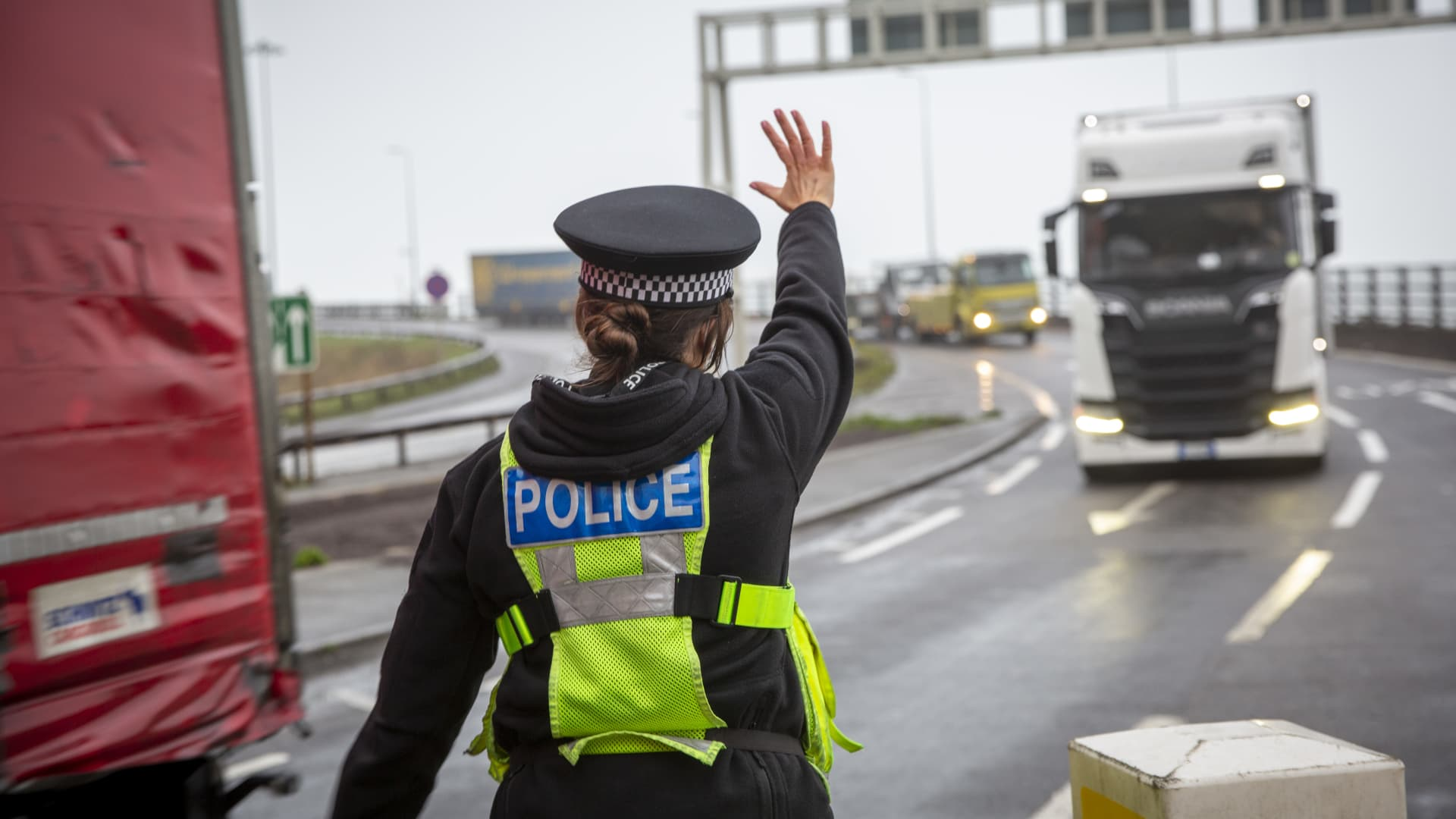 Police manage freight lorry drivers as the French border closures due to a new strain of COVID-19 at the entrance into the port of Dover in the Eastern Dock where the cross channel port is situated with ferries departing to go to Calais in France on the 21st of December 2020, Dover, Kent, United Kingdom.