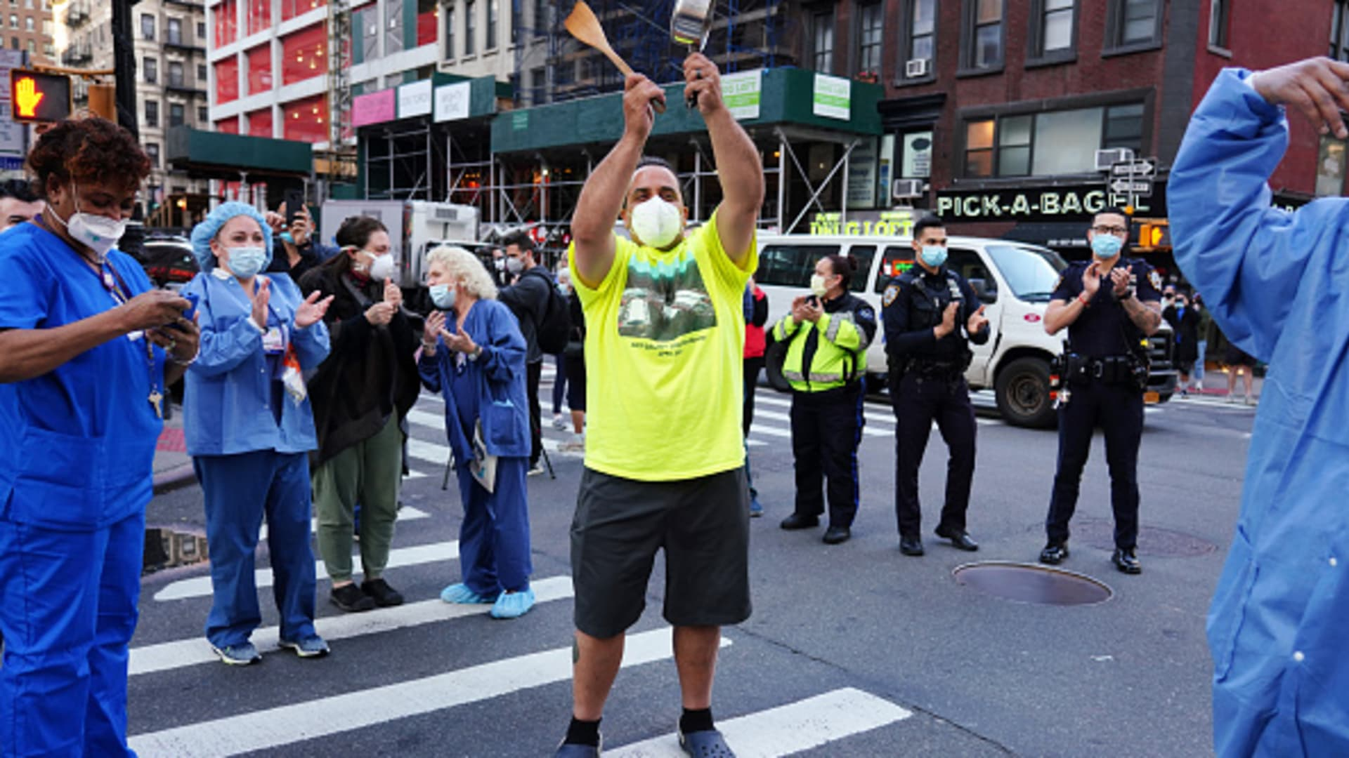 A man bangs a spatula against a pot to show gratitude to medical workers from Lenox Hill Hospital as part of the nightly #ClapBecauseWeCare during the coronavirus pandemic on May 07, 2020 in New York City.