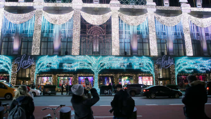 People near the Saks Fifth Avenue Christmas window displays in New York City on Nov. 25, 2020.