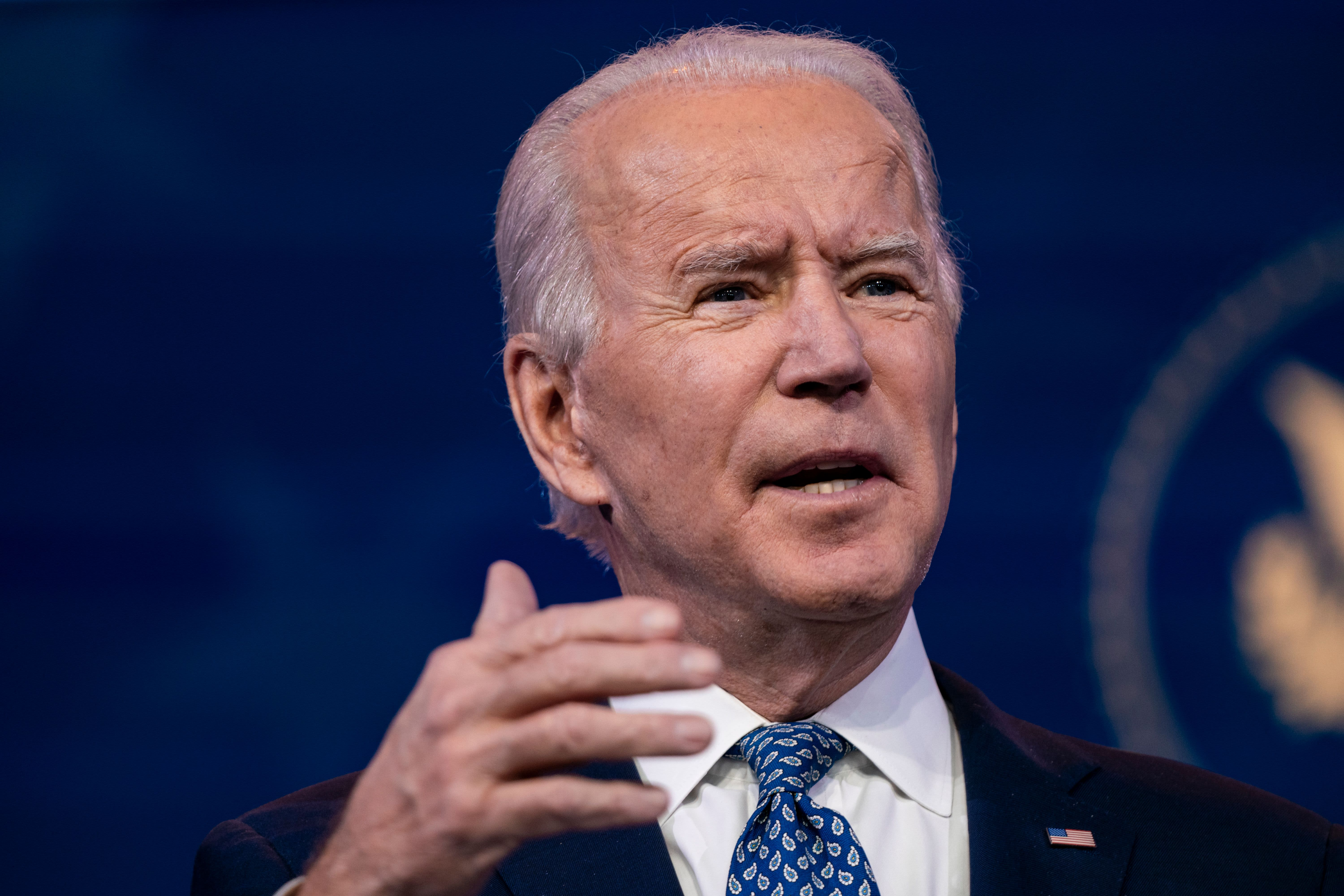 Biden slams Trump's vaccine effort, reiterates plan to administer 100 million doses in 100 days