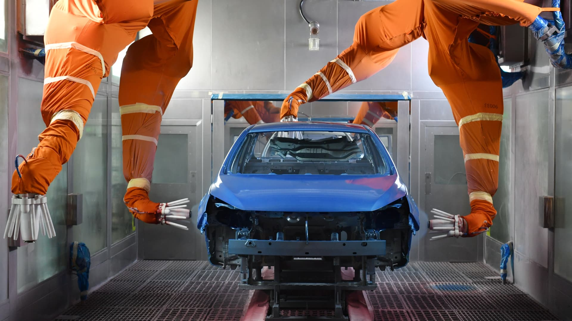 Robotic arms spray paint a car body shell at the BYD Automobile Company Limited Xi'an plant on December 25, 2019 in Xi'an, Shaanxi Province of China.