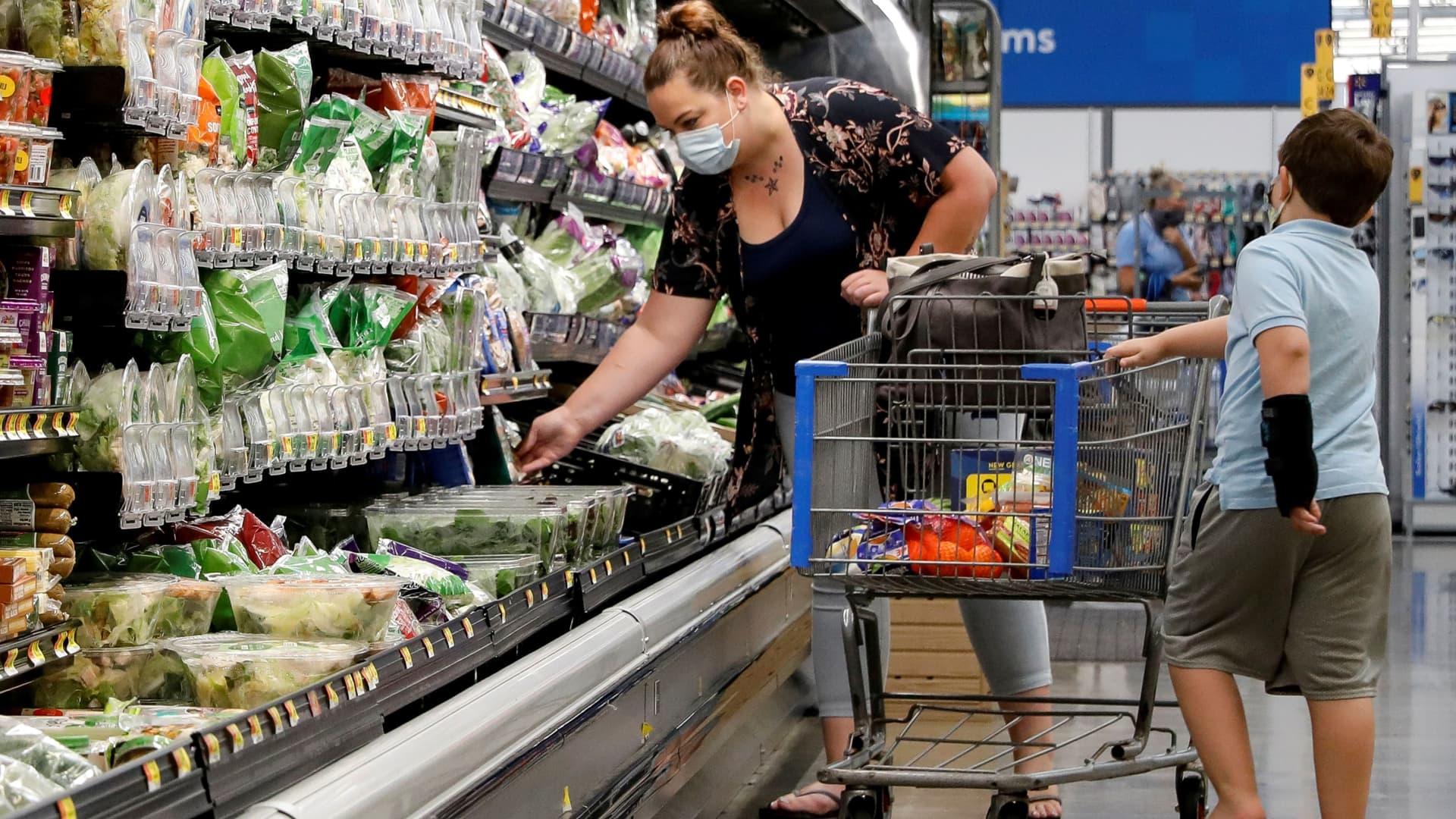 Shoppers are seen wearing masks while shopping at a Walmart store in Bradford, Pennsylvania, July 20, 2020.